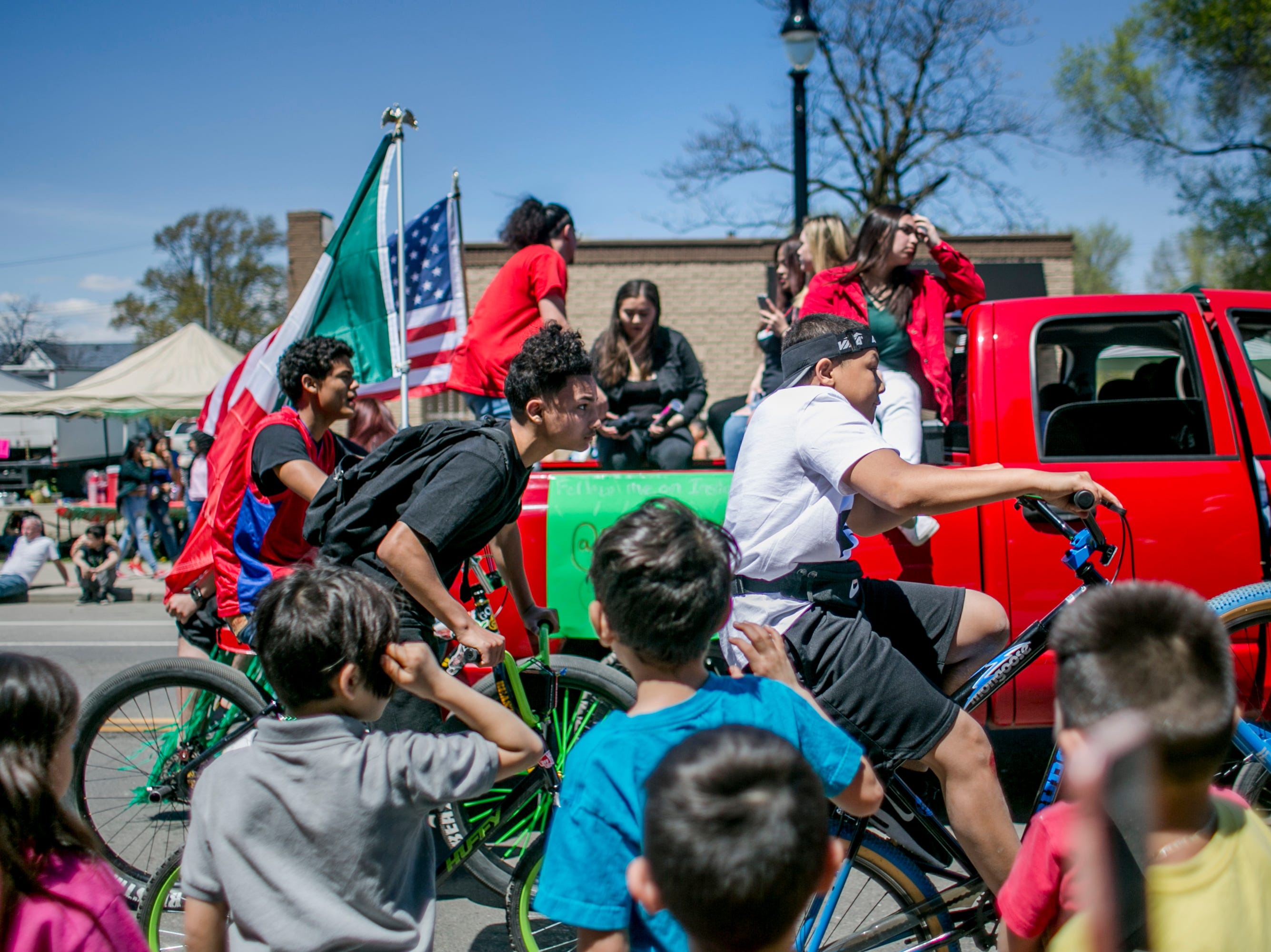 Chilfren ride bicycles in the 55th Annual Cinco de Mayo parade.