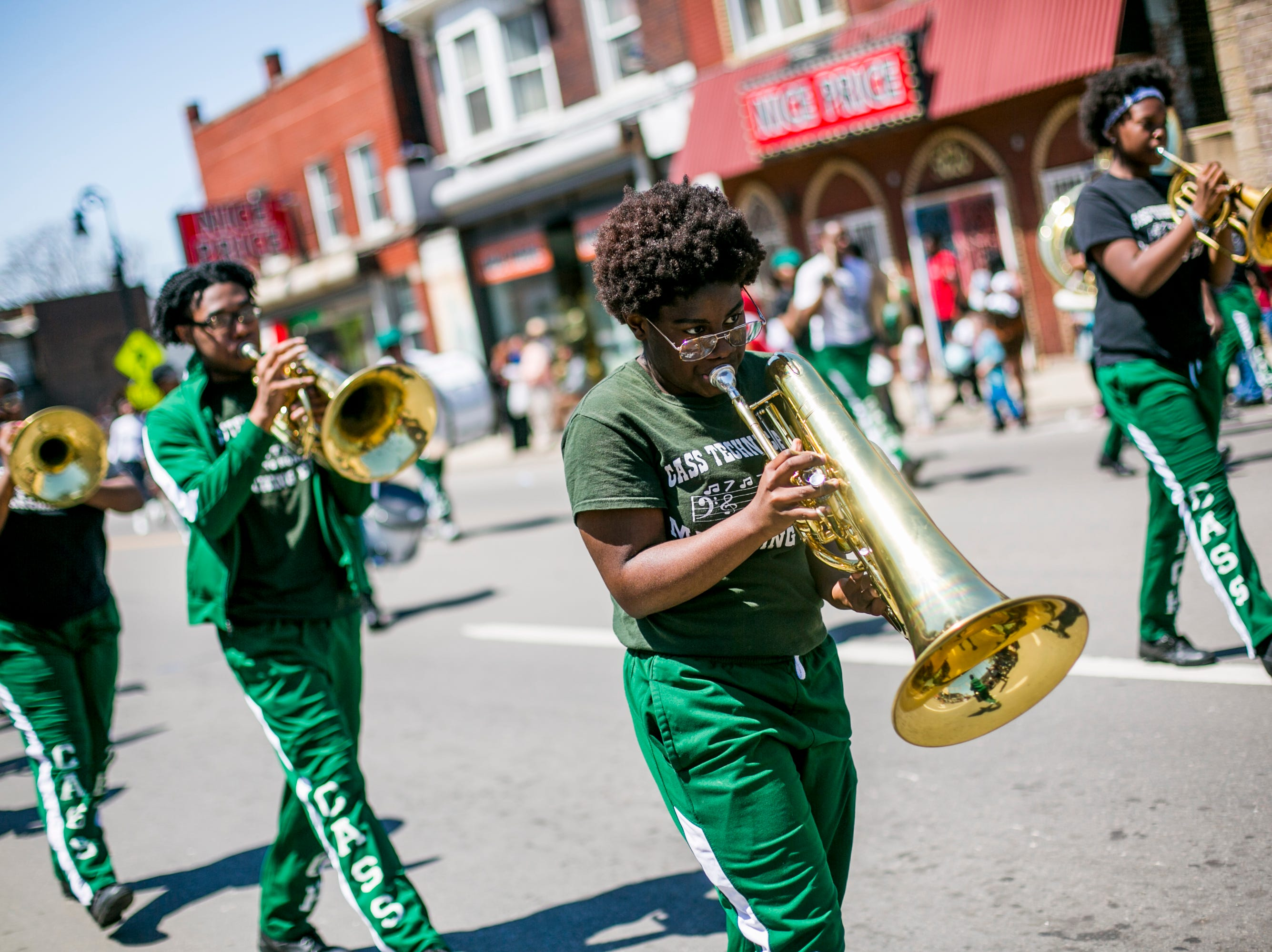 Members of the Cass Tech High School marching band perform in the 55th Annual Cinco de Mayo parade.