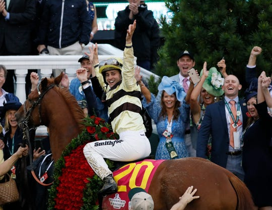 Flavien Prat celebrates after riding Country House to victory.