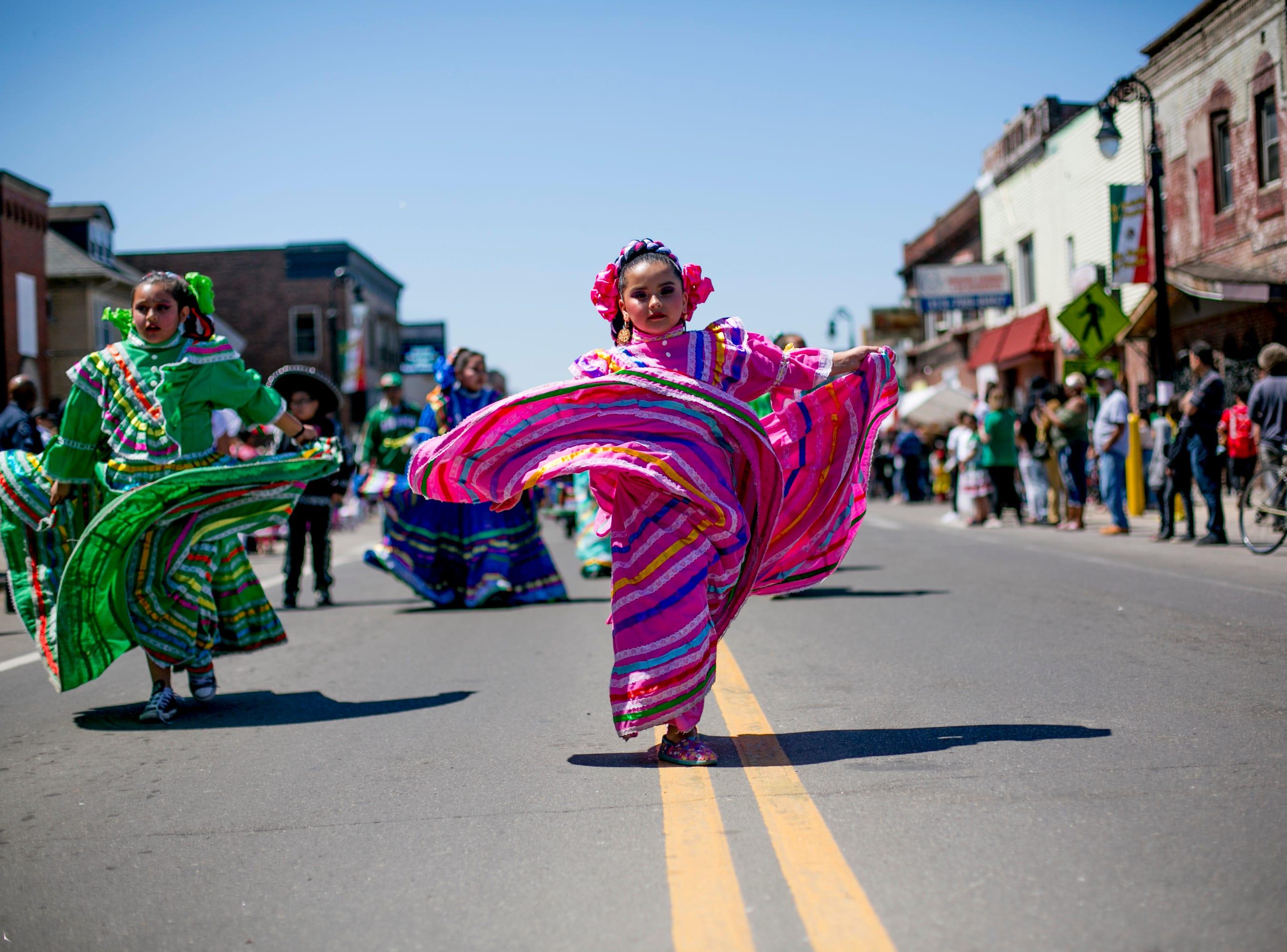 A girl from Ballet Folklórico De Detroit dances in the 55th Annual Cinco de Mayo parade along Vernor Highway in southwest Detroit, May 5, 2019.