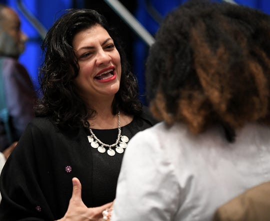 U.S. Rep. Rashida Tlaib, left, talks with Ellen Chamberlain, 32, of Farmington Hills at the NAACP 64th Annual Fight For Freedom Fund Dinner at Cobo Center in Detroit on May 5, 2019.
