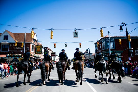 Members of the Detroit Police Mounted Unit ride in the the 55th Annual Cinco de Mayo parade.