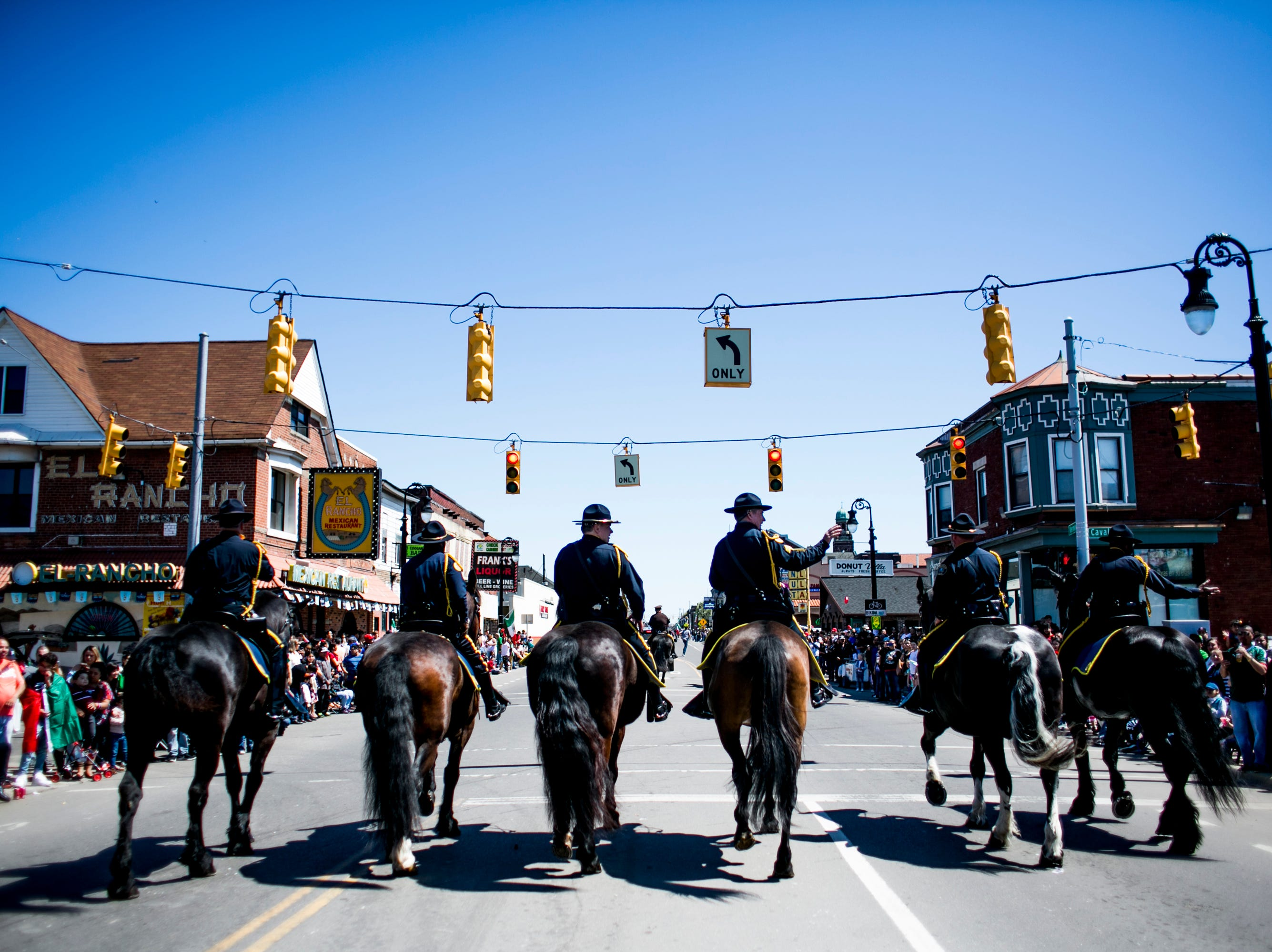 Members of the Detroit Police Mounted Unit rides in the the 55th Annual Cinco de Mayo parade.