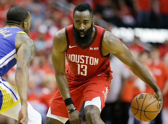 Houston Rockets guard James Harden (13) dribbles as Golden State Warriors guard Andre Iguodala defends during the second half of Game 3.