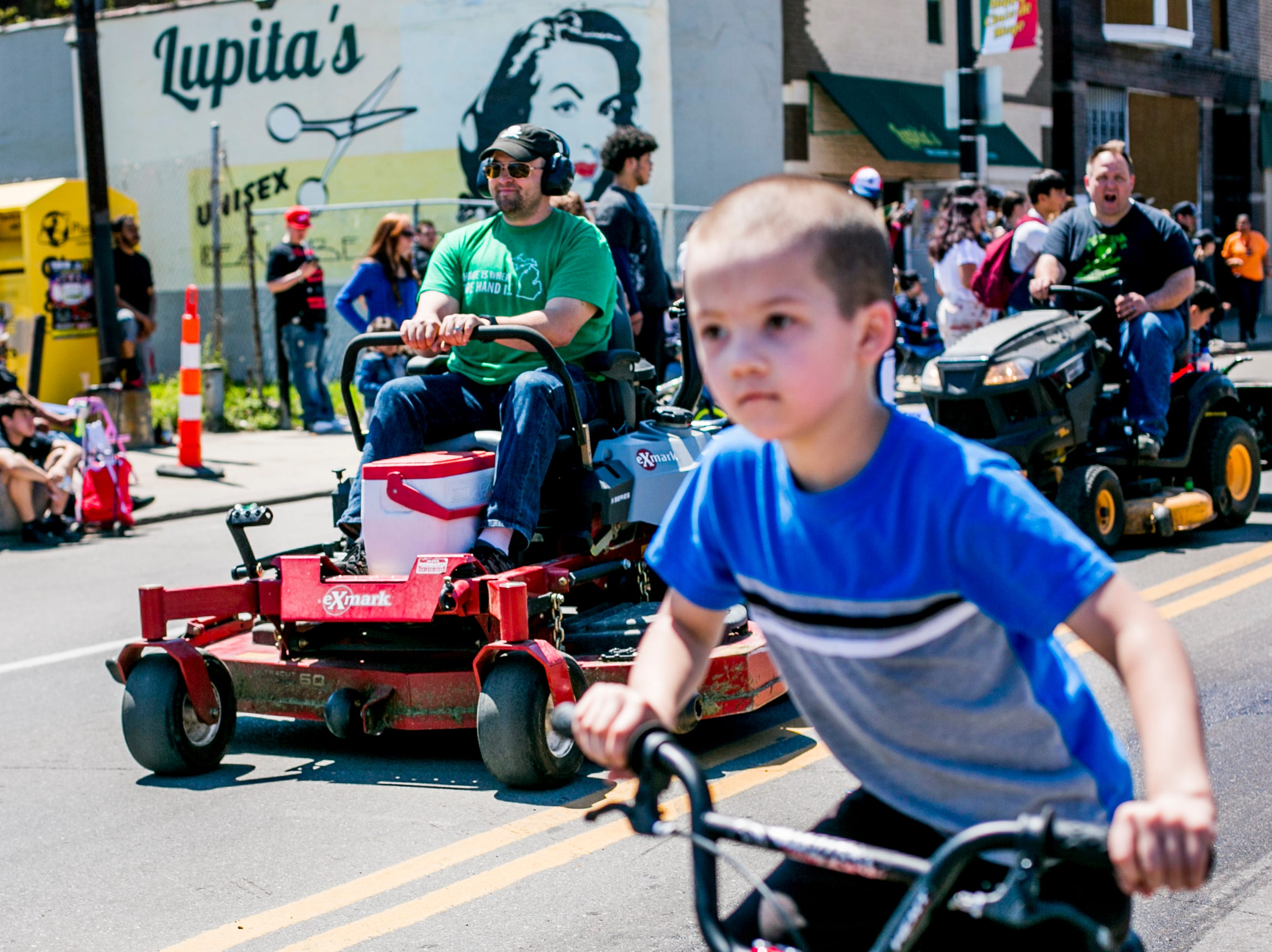 Members of the Detroit Mower Gang ride in the 55th Annual Cinco de Mayo parade along Vernor Highway.