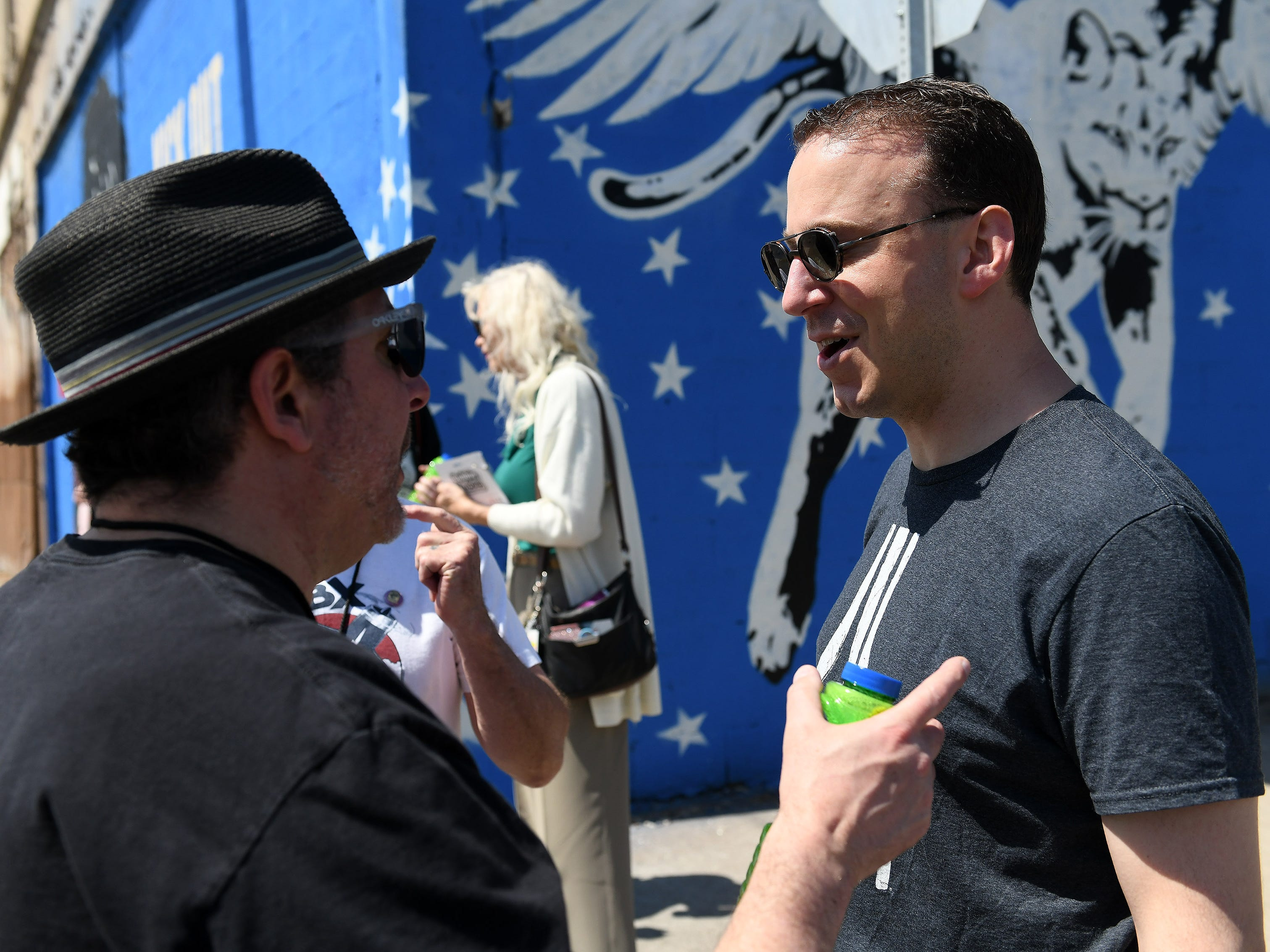 Andy Fradkin of Dearborn, a 1994 graduate of Dearborn High School and was a student of Russ Gibb, right, talks with filmmaker Tony D'Annunzio, left, about Russ Gibb. Fradkin was friends with Russ Gibb after graduating high school and is the executor of Gibb's will.  Memorial service details are still to come.