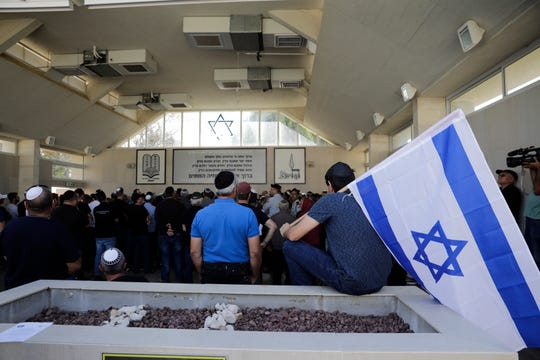 Israelis attend the funeral of Moshe Agadi in the city of Ashkelon, Israel, Sunday.May 5, 2019. Agadi was killed outside his home in Ashkelon by a rocket fired from Gaza Strip.