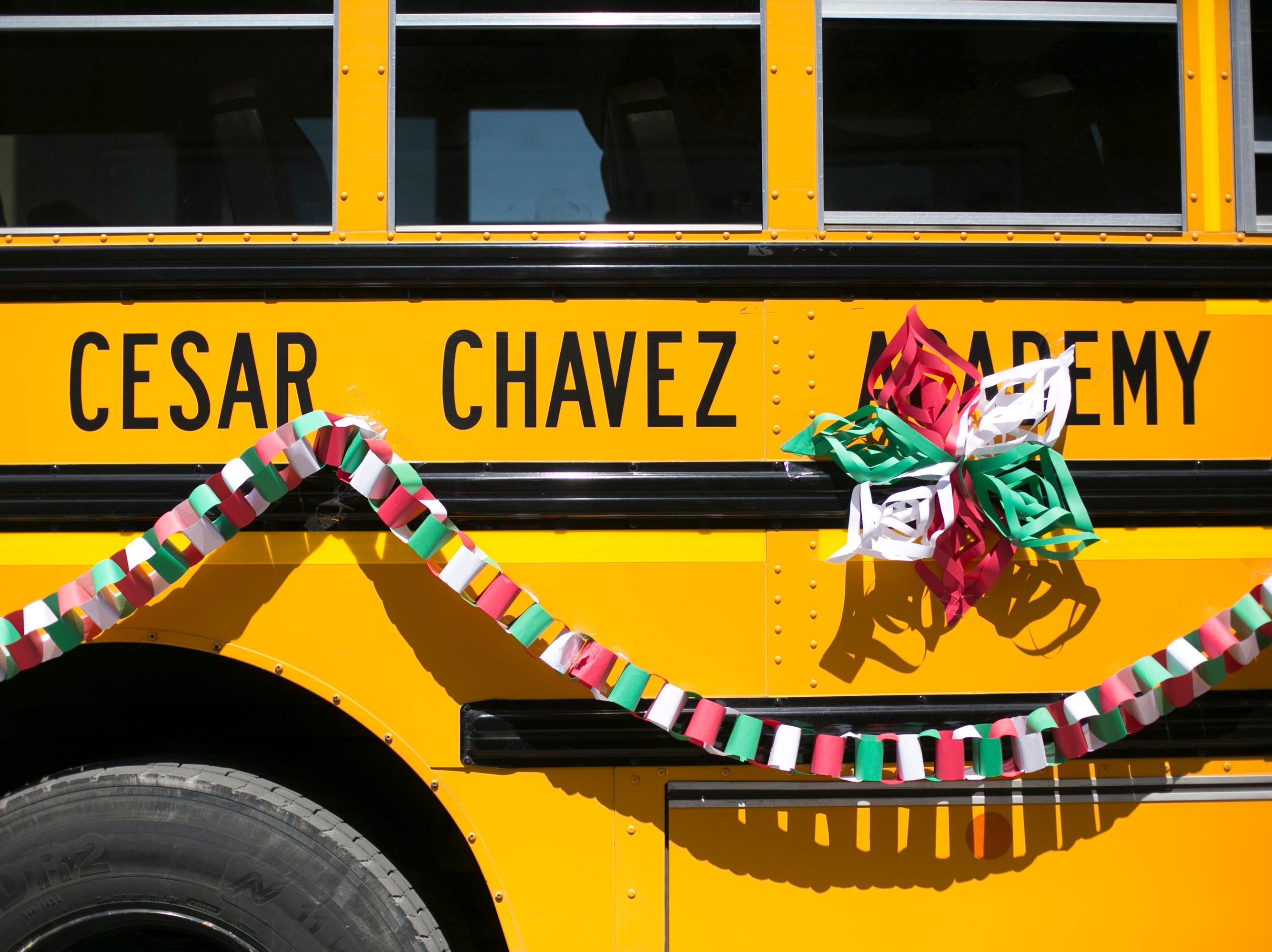 A school bus from Cesar Chavez Academy travels in the 55th Annual Cinco de Mayo parade.