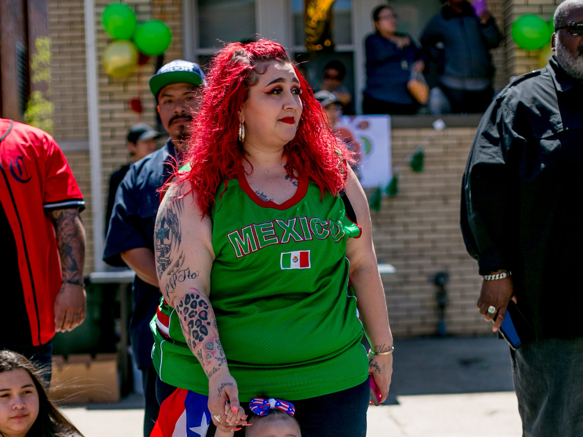 Season Colon and her 1-year-old daughter Araceli watch  the 55th Annual Cinco de Mayo parade along Vernor Highway in southwest Detroit.