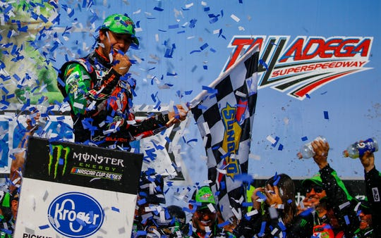 Chase Elliott, left, celebrates after winning a NASCAR Cup Series race at Talladega Superspeedway, Sunday, April 28, 2019, in Talladega, Ala.