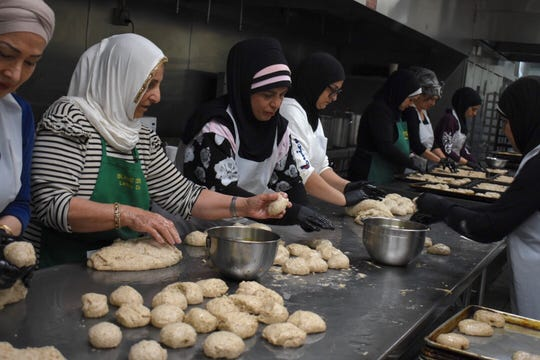 Some 20 volunteers craft 3,000 pieces of bread and over 1,800 cookies for the start of Ramadan, the Muslim holy month, at the Islamic Center of America in Dearborn, Michigan on May 5, 2019.