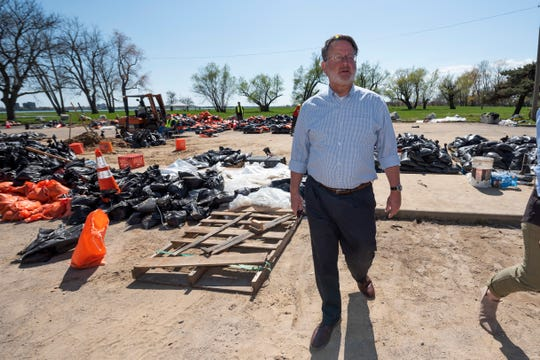 U.S. Senator Gary Peters walks through a sandbag filling station at Alfred Brush Ford Park in Detroit as he toured flood-damaged areas on Sunday, days after historic rainfall caused widespread flooding in Metro Detroit.