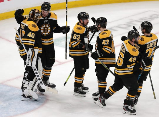 Boston Bruins goaltender Tuukka Rask (40) is congratulated after a win against the Columbus Blue Jackets in Game 5.