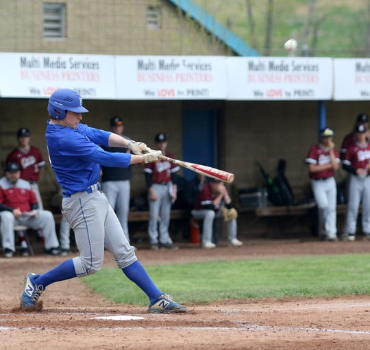Henry Juan of Horseheads hits an RBI double against Elmira in the first game of a doubleheader May 4, 2019 at Dunn Field.