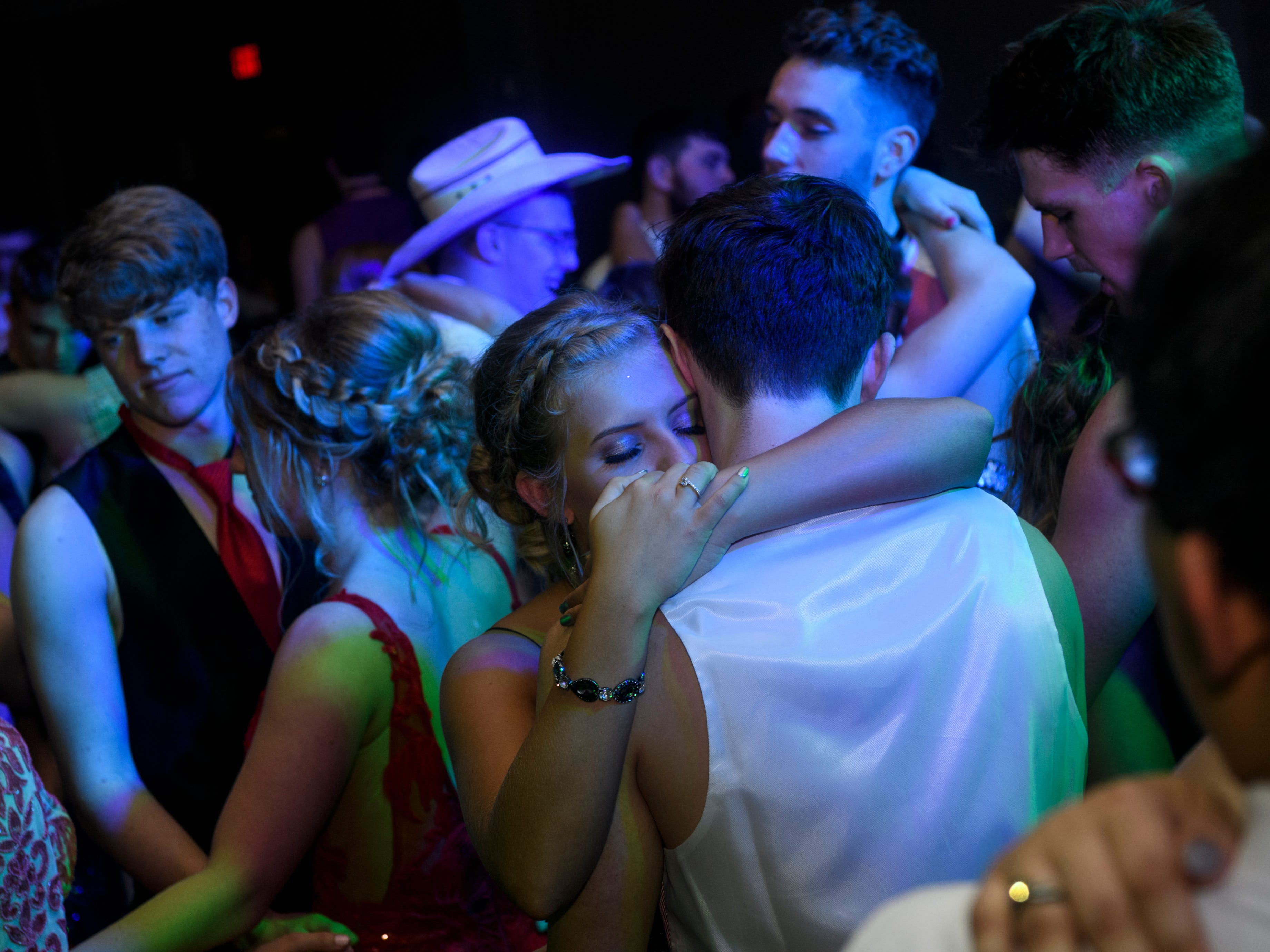 Students slow dance during Mt. Vernon's prom held inside the University of Southern Indiana's Carter Hall in Evansville, Ind., Saturday, May 4, 2019.