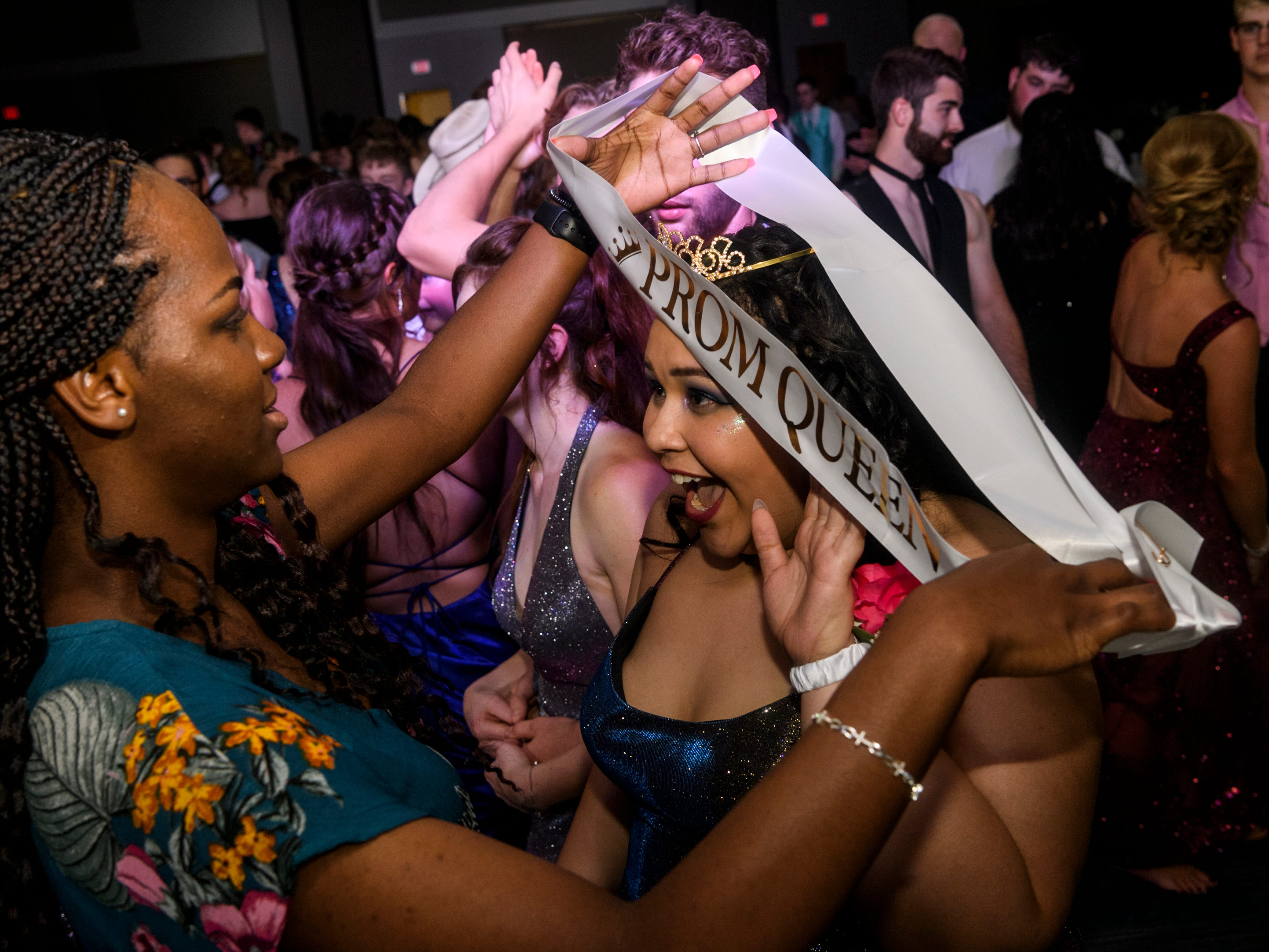 Mt. Vernon senior Bralyn Shripka, right, reacts to being crowned Prom Queen during the dance at the University of Southern Indiana's Carter Hall in Evansville, Ind., Saturday, May 4, 2019.