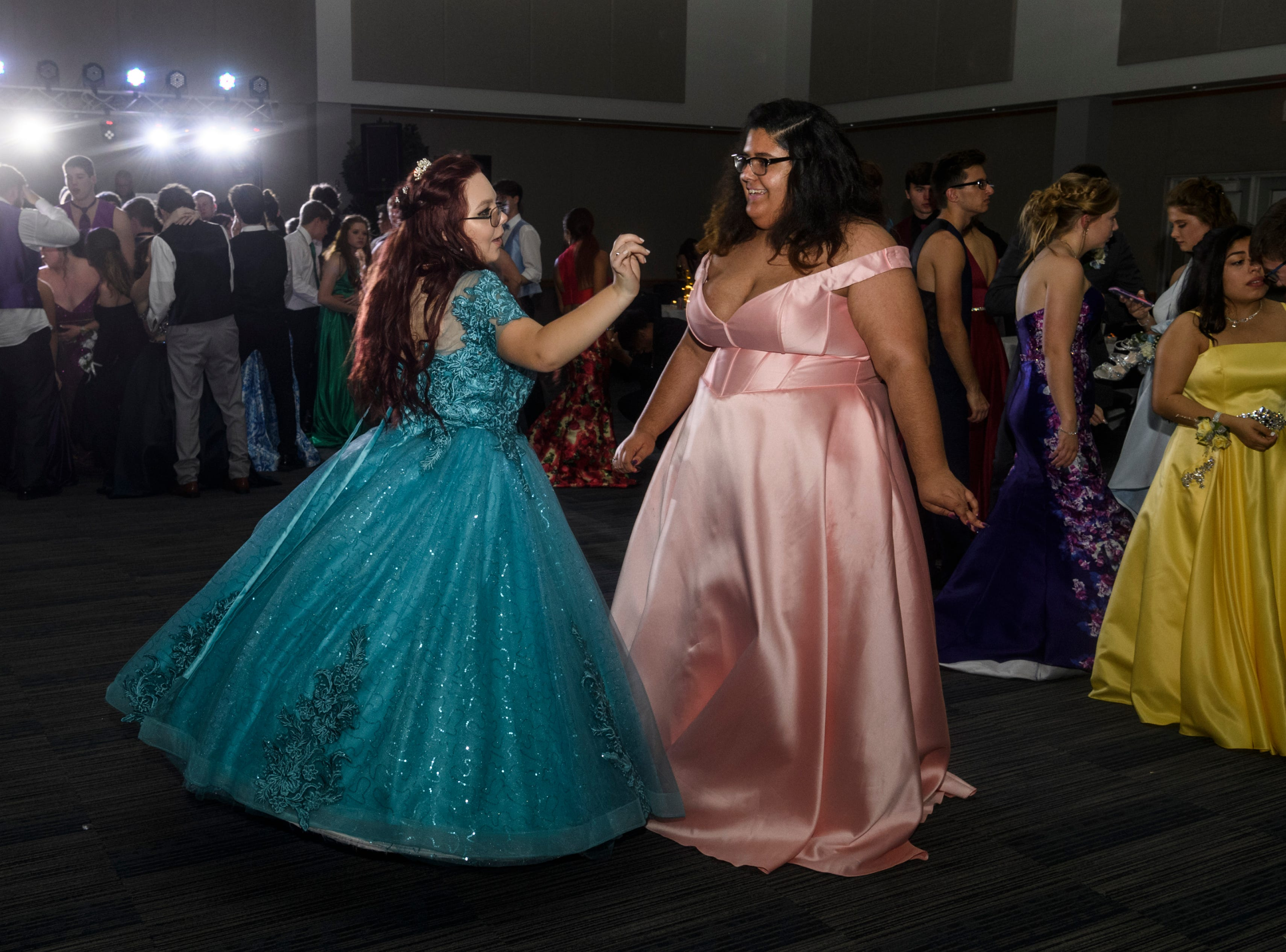 Mt. Vernon juniors Alexis Adamaitis, left, and Felicitie Flemmings, right, dance together during prom held inside the University of Southern Indiana's Carter Hall in Evansville, Ind., Saturday, May 4, 2019.
