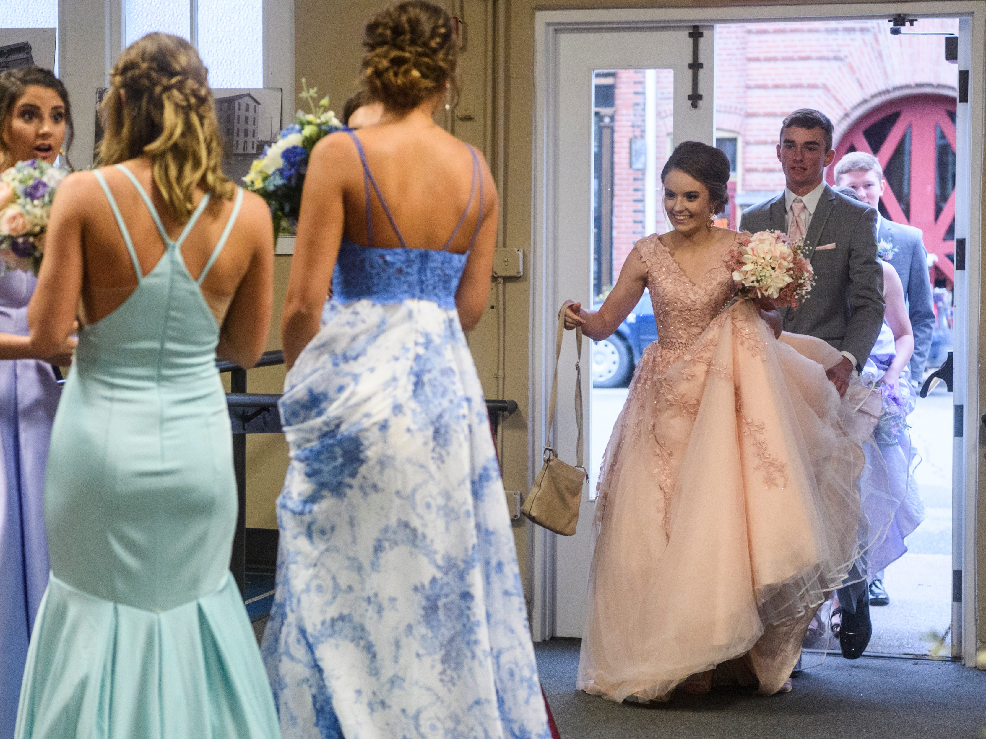 North Posey senior Emily Fortune, center right, smiles as she is greeted by friends as she and her prom date Johnson Koester walk into the Ribeyre Center in New Harmony, Ind., Saturday, May 4, 2019. About 240 tickets were sold for this year's prom.