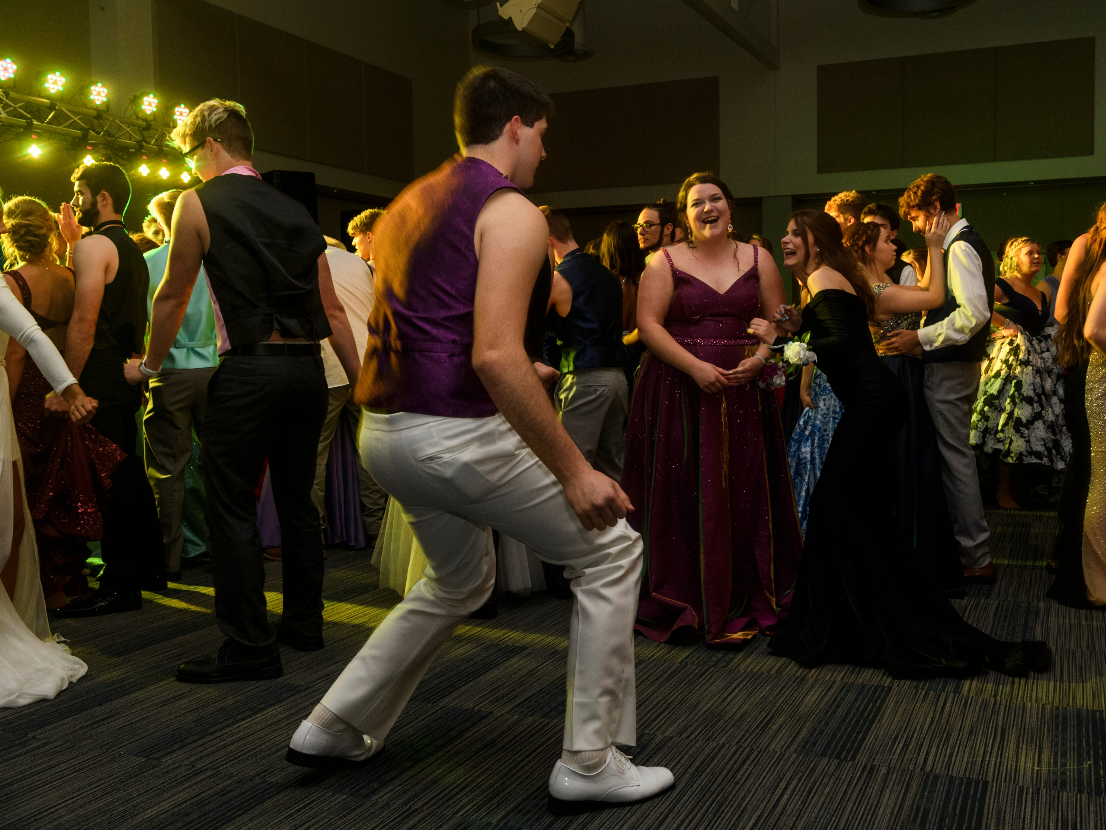 Students dance the night away during Mt. Vernon's prom held inside the University of Southern Indiana's Carter Hall in Evansville, Ind., Saturday, May 4, 2019.