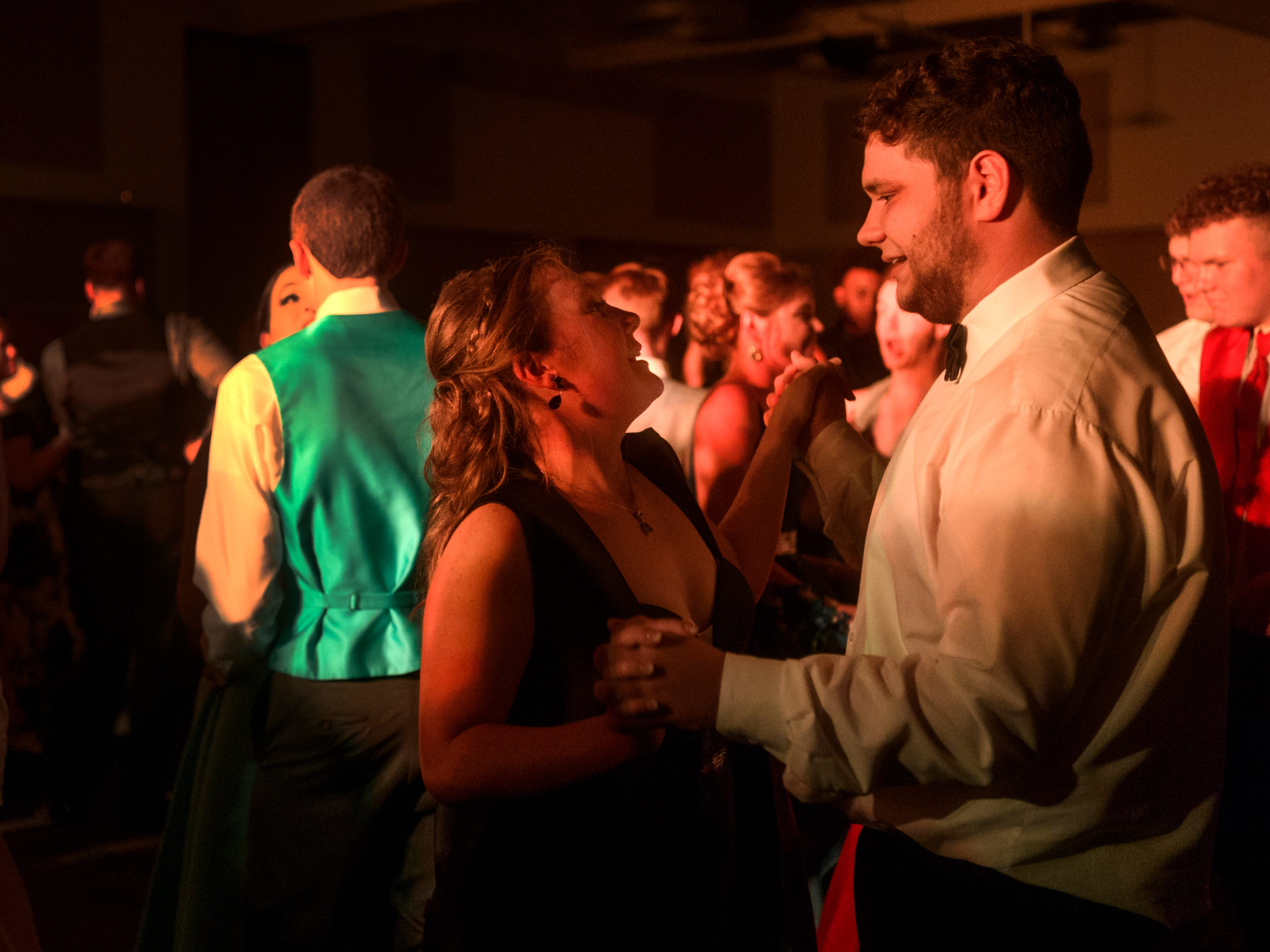 Hannah Nurrenbern, left, and Cameron McIntyre, right, dance together during Mt. Vernon's prom held inside the University of Southern Indiana's Carter Hall in Evansville, Ind., Saturday, May 4, 2019.