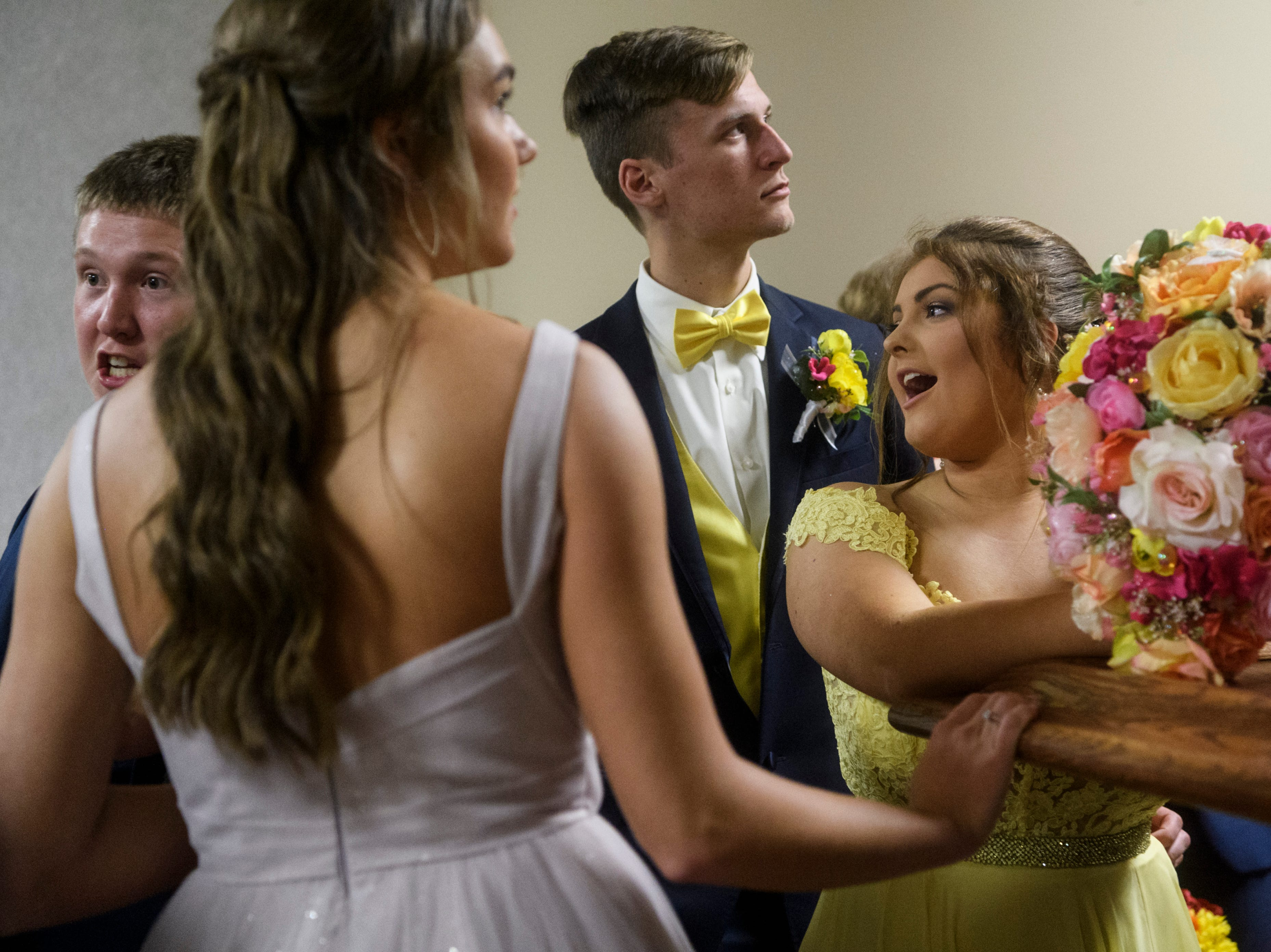 """North Posey students wait in line for the beginning of the """"Grand March"""" where they are introduced one by one and paraded around in front of family and friends before starting prom at the Ribeyre Center in New Harmony, Ind., Saturday, May 4, 2019."""