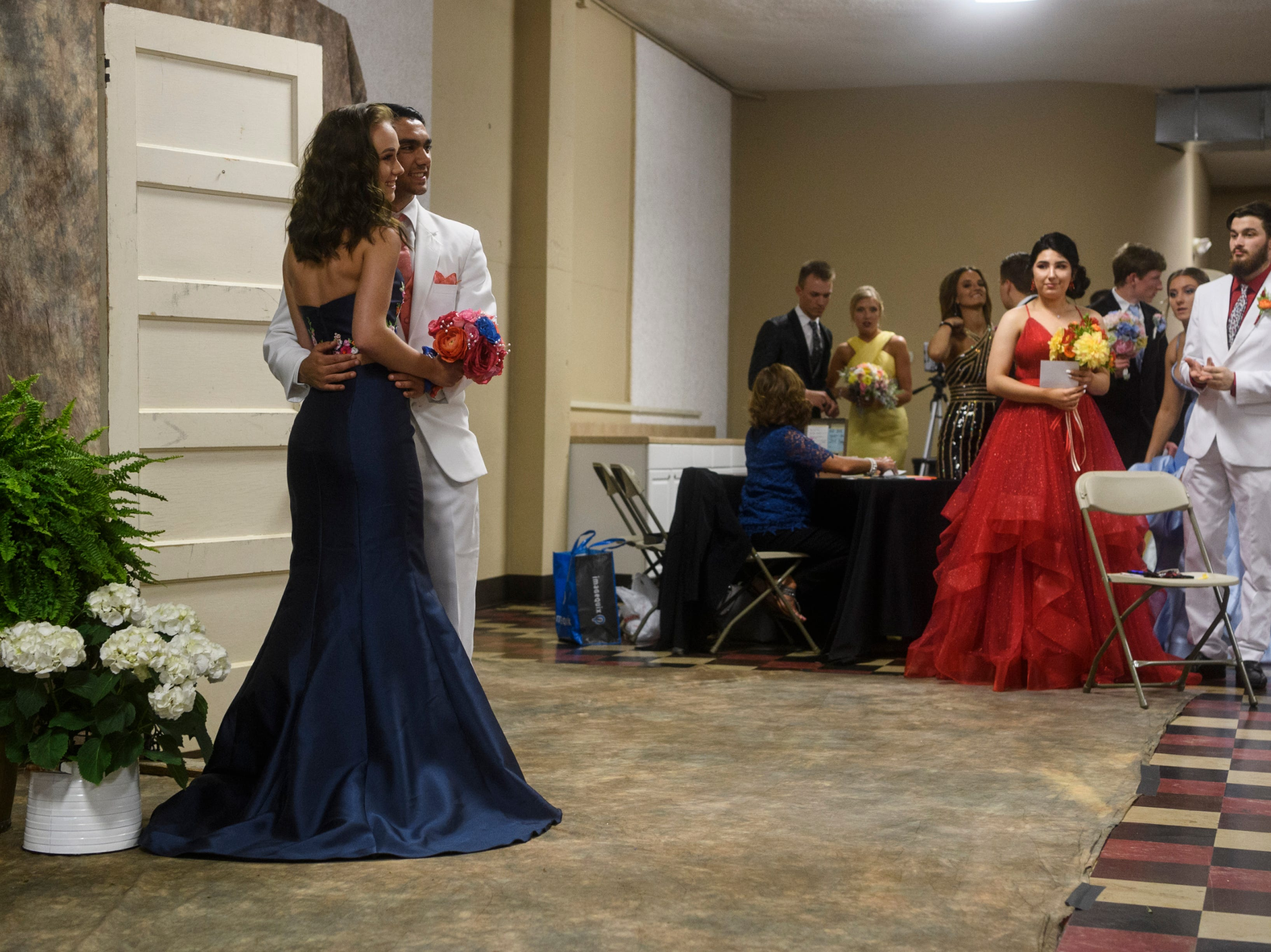 Students get their portraits taken by the Straub Photography group before the start of North Posey's prom held at the Ribeyre Center in New Harmony, Ind., Saturday, May 4, 2019.
