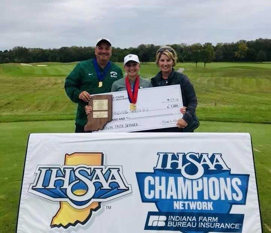 Katelyn Skinner (middle) celebrates with her father John (left) and mother Tamara (right) after winning the Mental Attitude Award.