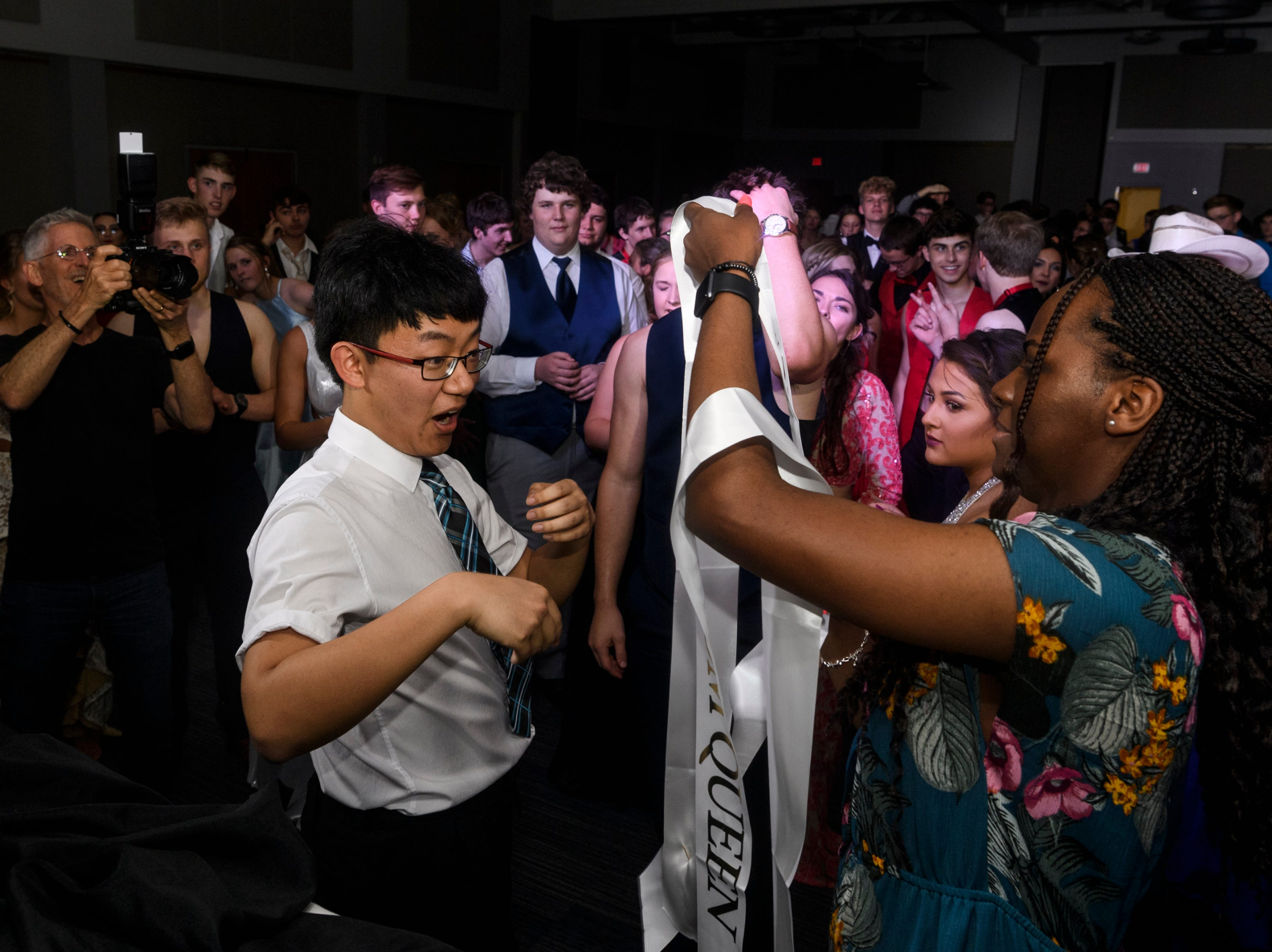 Mt. Vernon senior Yuxuan Bai reacts to being named prom king during prom held inside the University of Southern Indiana's Carter Hall in Evansville, Ind., Saturday, May 4, 2019.