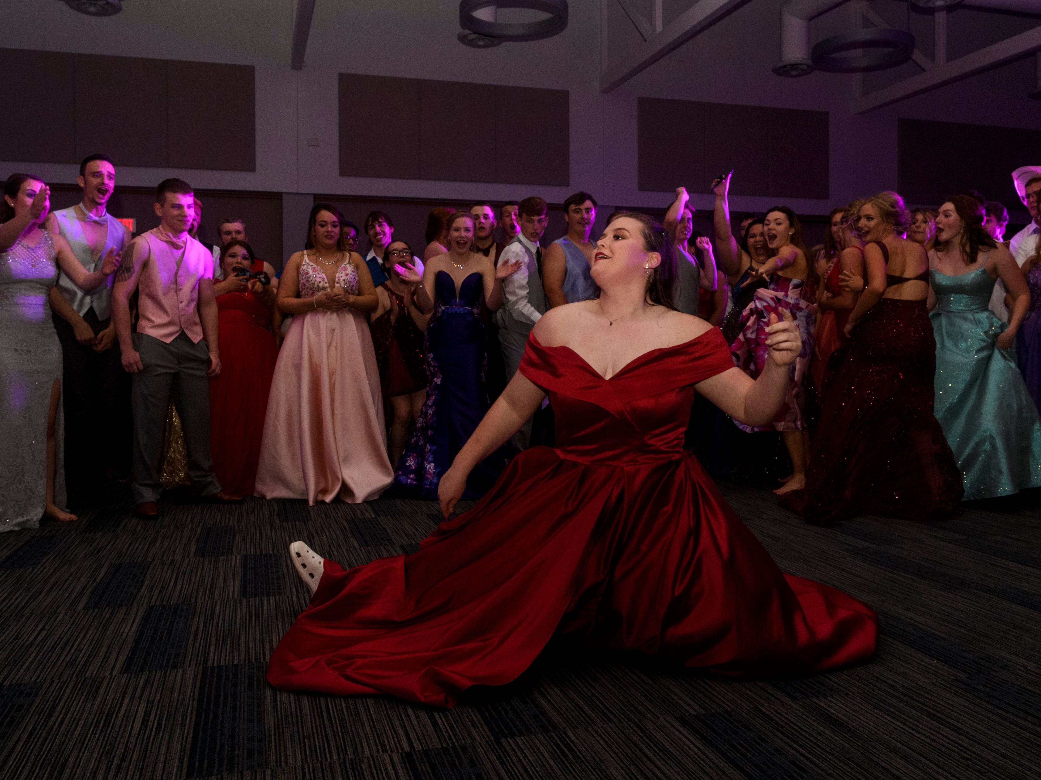 A student shows off in the dance circle during Mt. Vernon's prom held inside the University of Southern Indiana's Carter Hall in Evansville, Ind., Saturday, May 4, 2019.