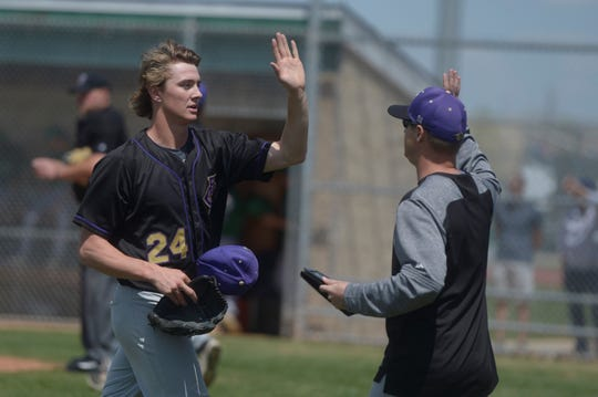 Fort Collins High School baseball player Kellen Voggesser, shown receiving a high-five after pitching out of a jam in a May 4, 2019, game against Fossil Ridge, and his teammates have a home game scheduled for 4 p.m. Tuesday against Broomfield.