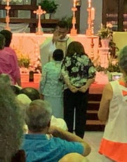 Esther Batista, a native of Santiago in the Dominican Republic, celebrated turning 102 on Sunday at St. Andrew Catholic Church in Cape Coral. Pastor Eduardo Coll gave her a special blessing during Sunday services.