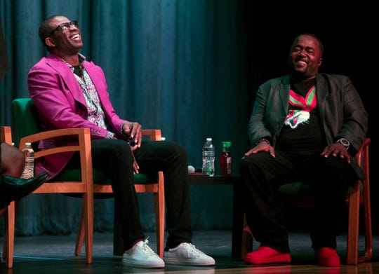 Deion Sanders, left, a North Fort Myers High School graduate, shares portions of his life story with members of the community on Saturday at Fort Myers High School. Sanders and friend Antong Lucky, right, also shared ideas on improving the communities of Southwest Florida.