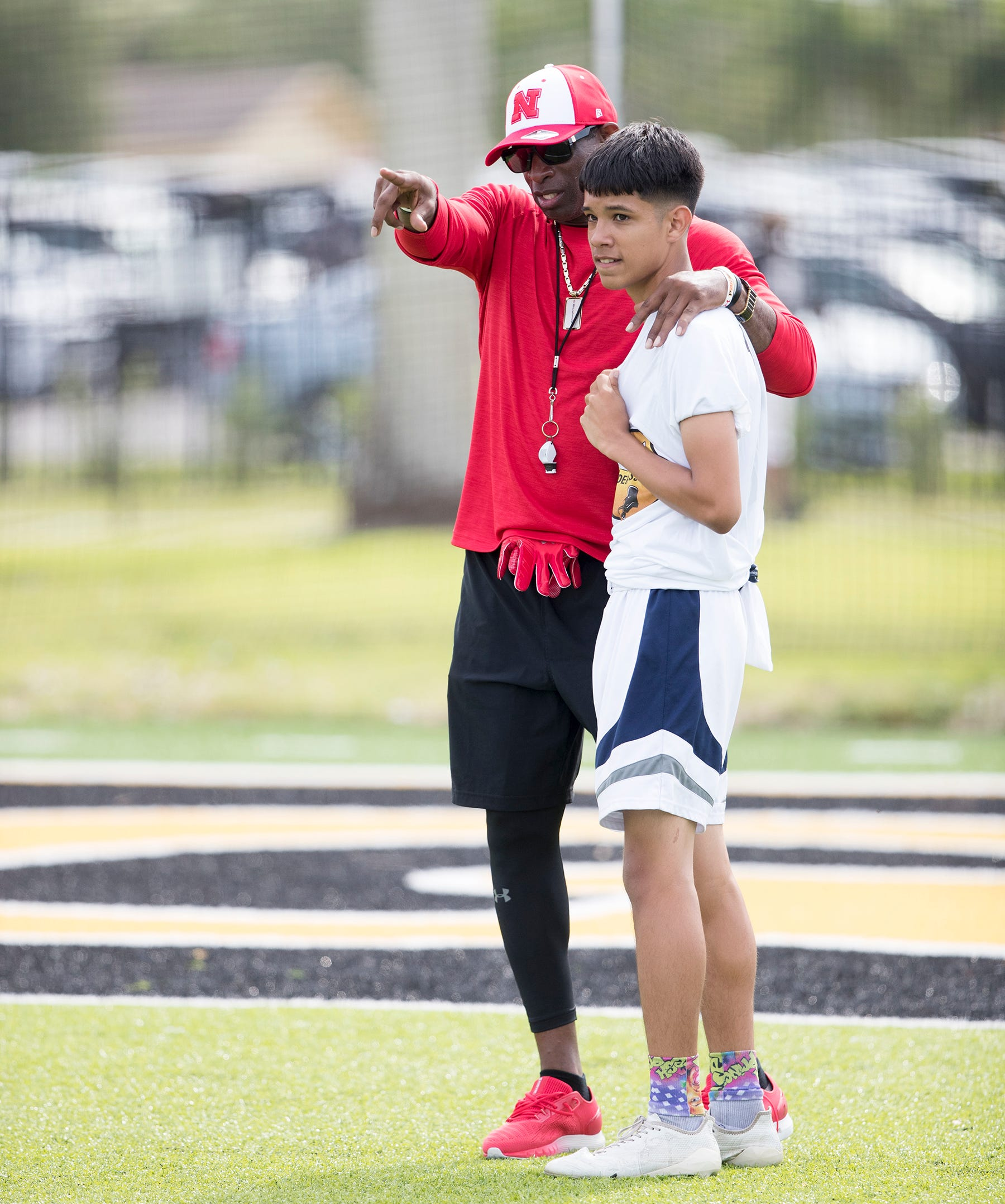 Deion Sanders leads the Prime Elite Underclassmen Football Camp on Sunday at Bishop Verot in Fort Myers. More than 700 middle and high school athletes attended  the camp that was put on by Under Armour and Deion Sanders.