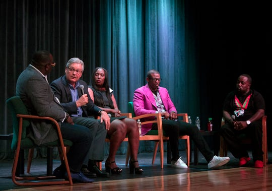 Omar Johnson, left, Fort Myers Mayor Randy Henderson, Councilwoman Terolyn P. Watson, Deion Sanders and Antong Lucky share ideas on improving the communities of Southwest Florida on Saturday at Fort Myers High School. Sanders, a North Fort Myers High School graduate, shared portions of his life story as well.