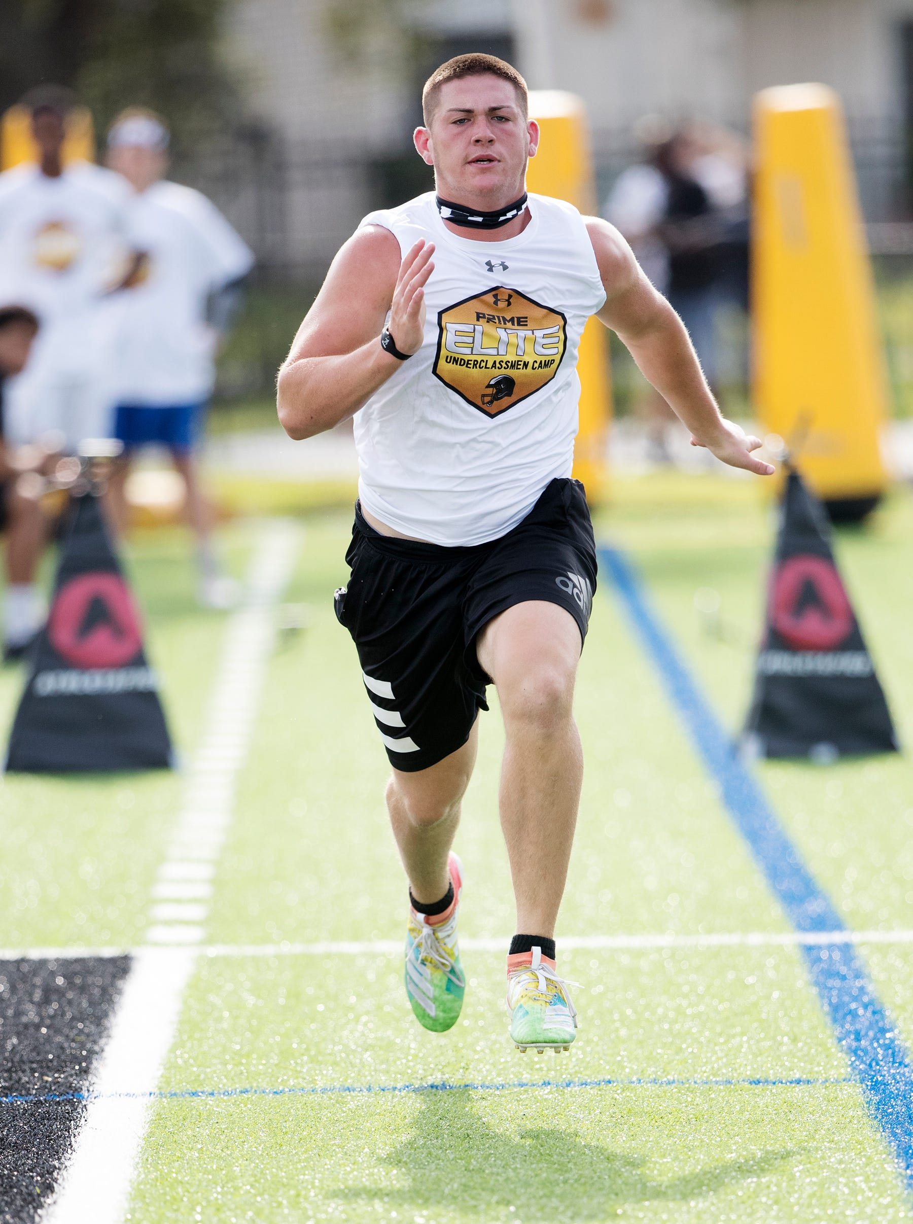 Treasure Coast High School's Keegan Davis competes in the Prime Elite Underclassmen Football Camp on Sunday at Bishop Verot in Fort Myers. More than 700 middle and high school athletes attended the camp that was put on by Under Armour and Deion Sanders.