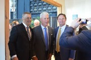 Long-time friends, from left, Mike Reinfeldt, Ted Thompson and Mike Renfro get their picture taken during the Green Bay Packers Hall of Fame induction banquet on May 4, 2019, at Lambeau Field.