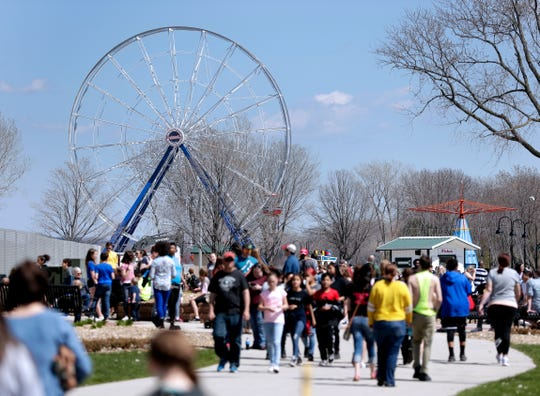 The Big Wheel, Bay Beach Amusement Park's new ride that is still being built, towers over guests on opening day of the park's 2019 season.