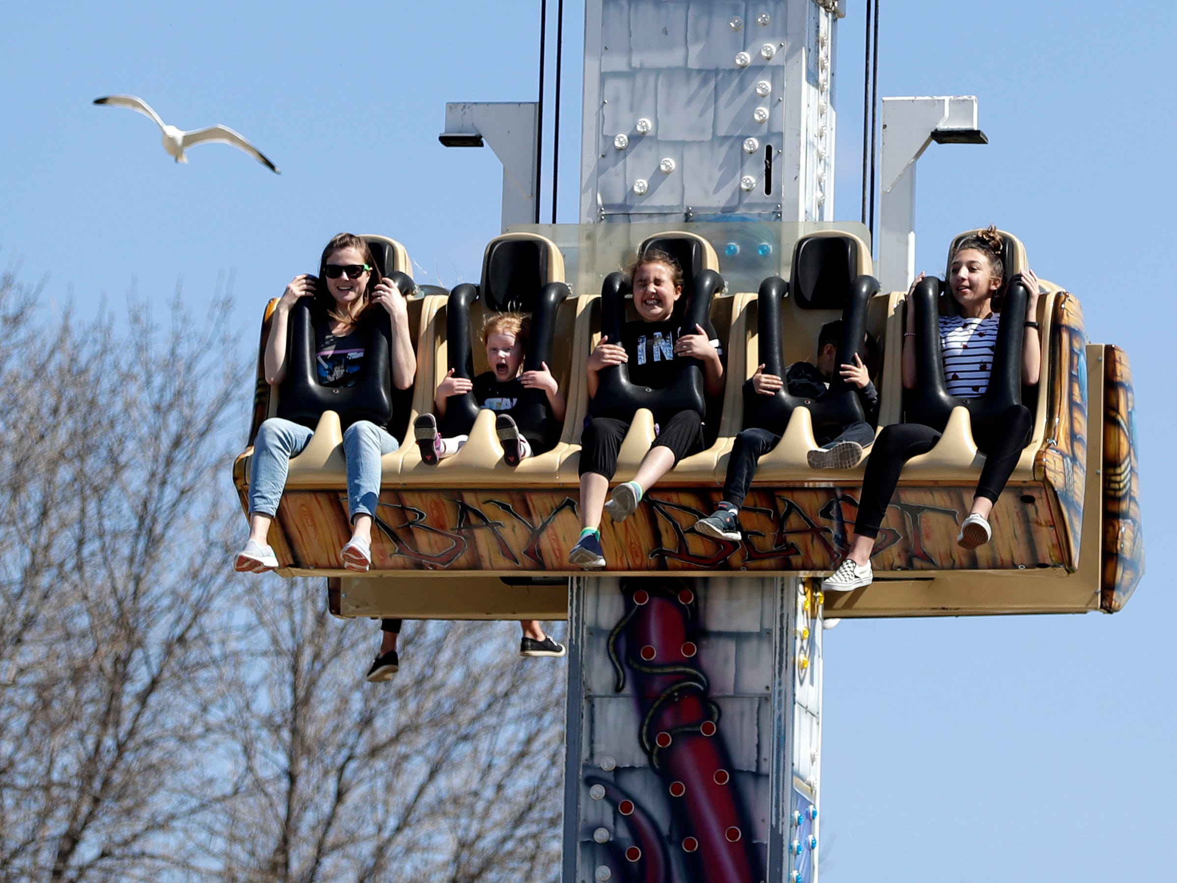 Riders brace themselves as they drop from the top of Bay Beast on May 4, 2019, the first day of the 2019 season at Bay Beach Amusement Park in Green Bay, Wis. Sarah Kloepping/USA TODAY NETWORK-Wisconsin