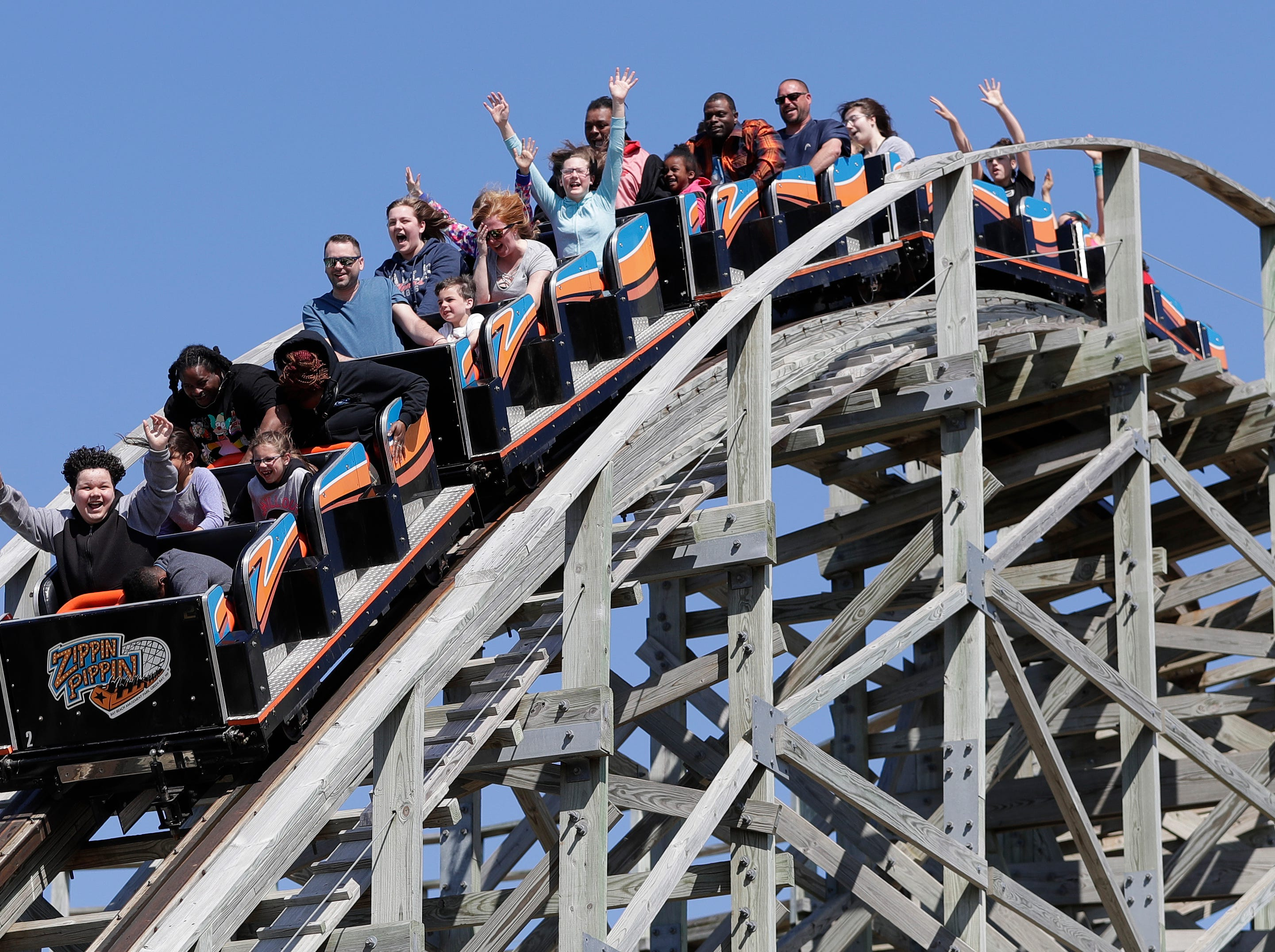 Riders prepare for a drop on the Zippin Pippin roller coaster at Bay Beach Amusement Park on May 4, 2019, the first day of the 2019 season, in Green Bay, Wis. Sarah Kloepping/USA TODAY NETWORK-Wisconsin