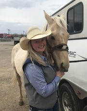 Providence freshman and CMR graduate Stephanie Rollins, with her horse Isaac, prior to Saturday's short round at the Big Sky Region College Finals Rodeo at Four Seasons Arena.