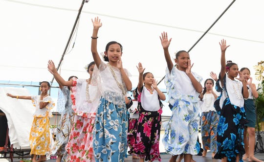 Students of M.U. Lujan Elementary School give a cultural performance during the St. Joseph Coconut Festival in Inarajan, May 5, 2019.