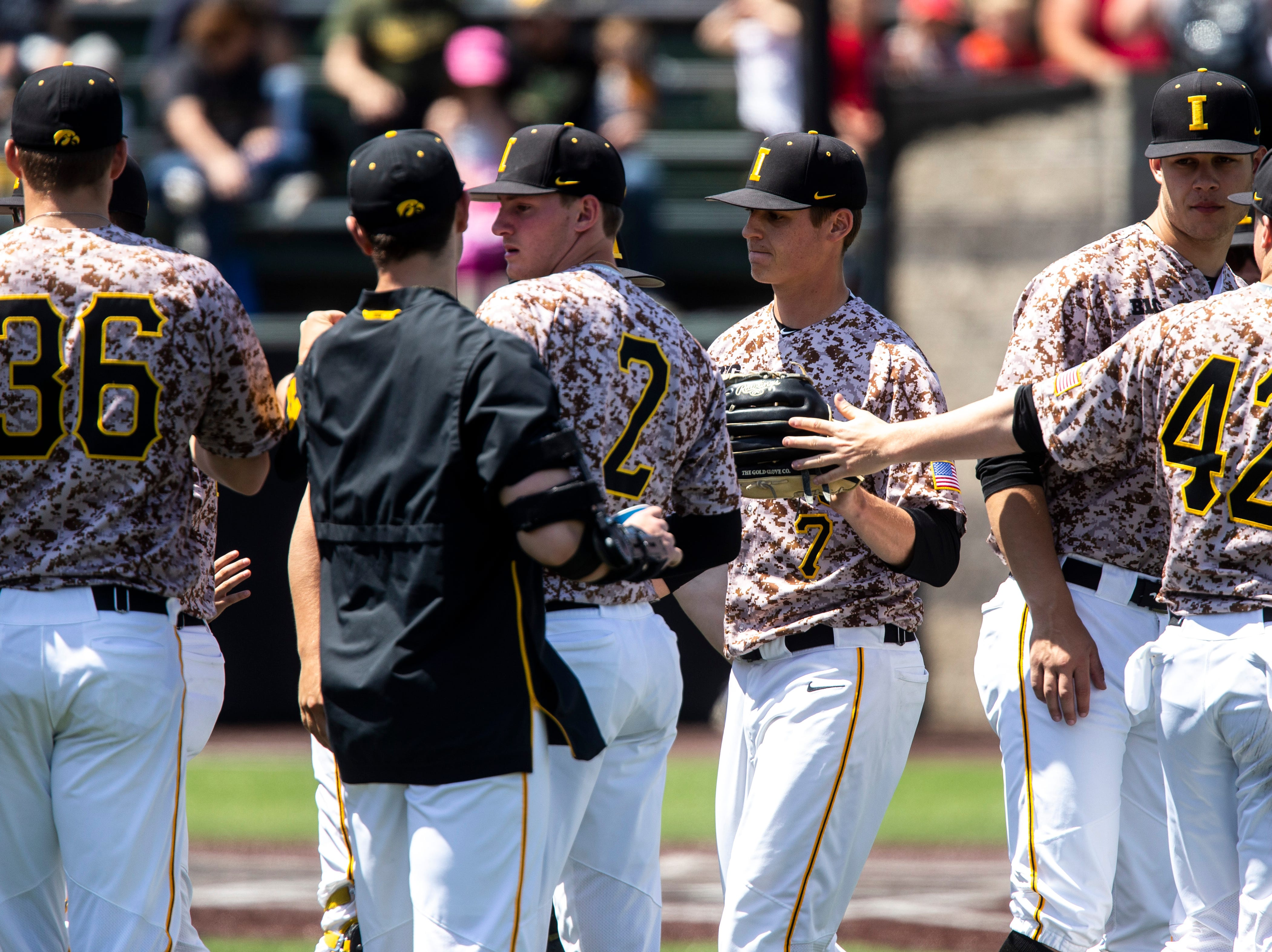Iowa pitcher Grant Judkins (7) walks into the dugout during a NCAA non conference baseball game, Sunday, May 5, 2019, at Duane Banks Field in Iowa City, Iowa.