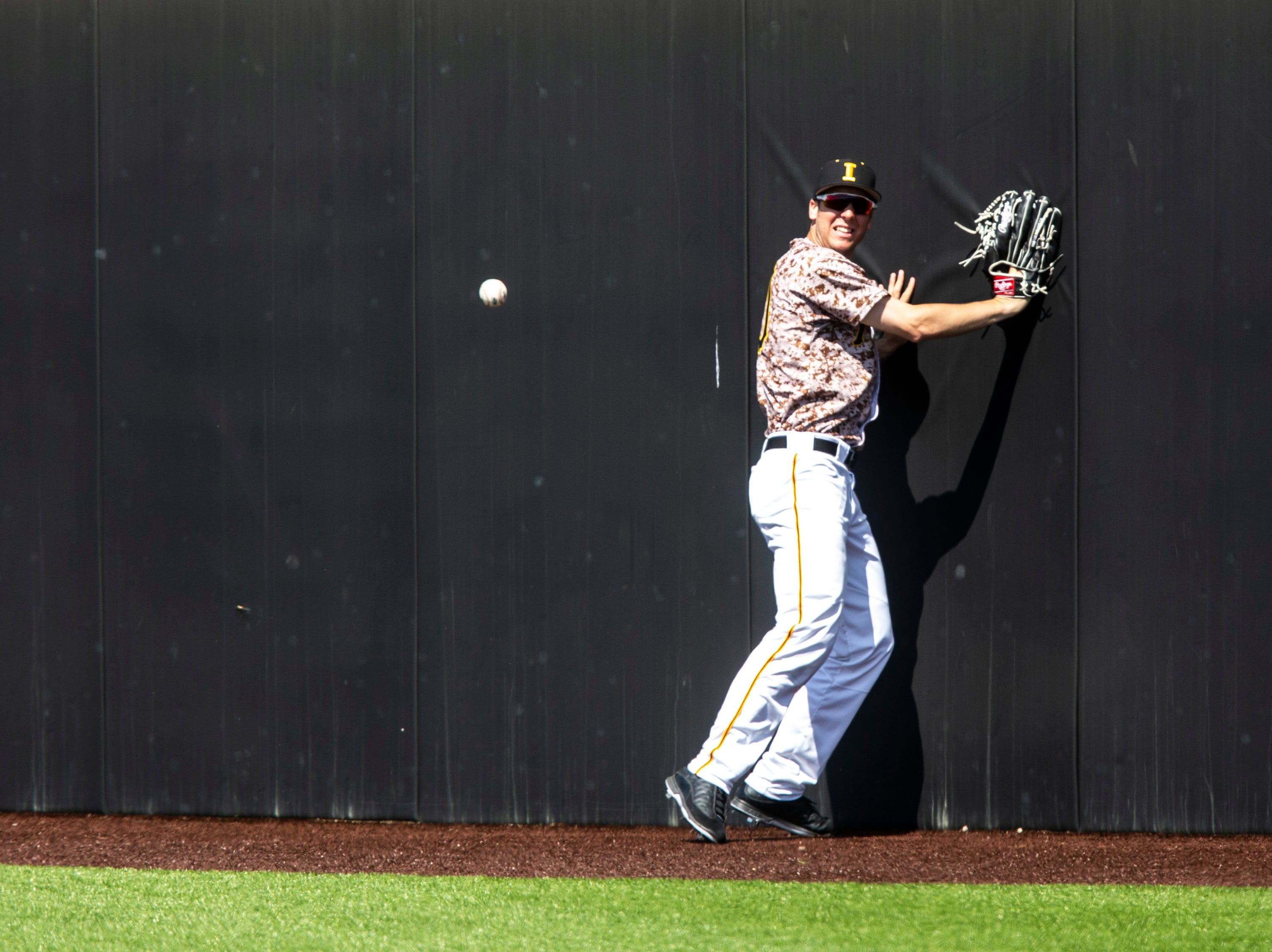 Iowa's Connor McCaffery (30) watches as a ball bounces past him at the right field wall during a NCAA non conference baseball game, Sunday, May 5, 2019, at Duane Banks Field in Iowa City, Iowa.