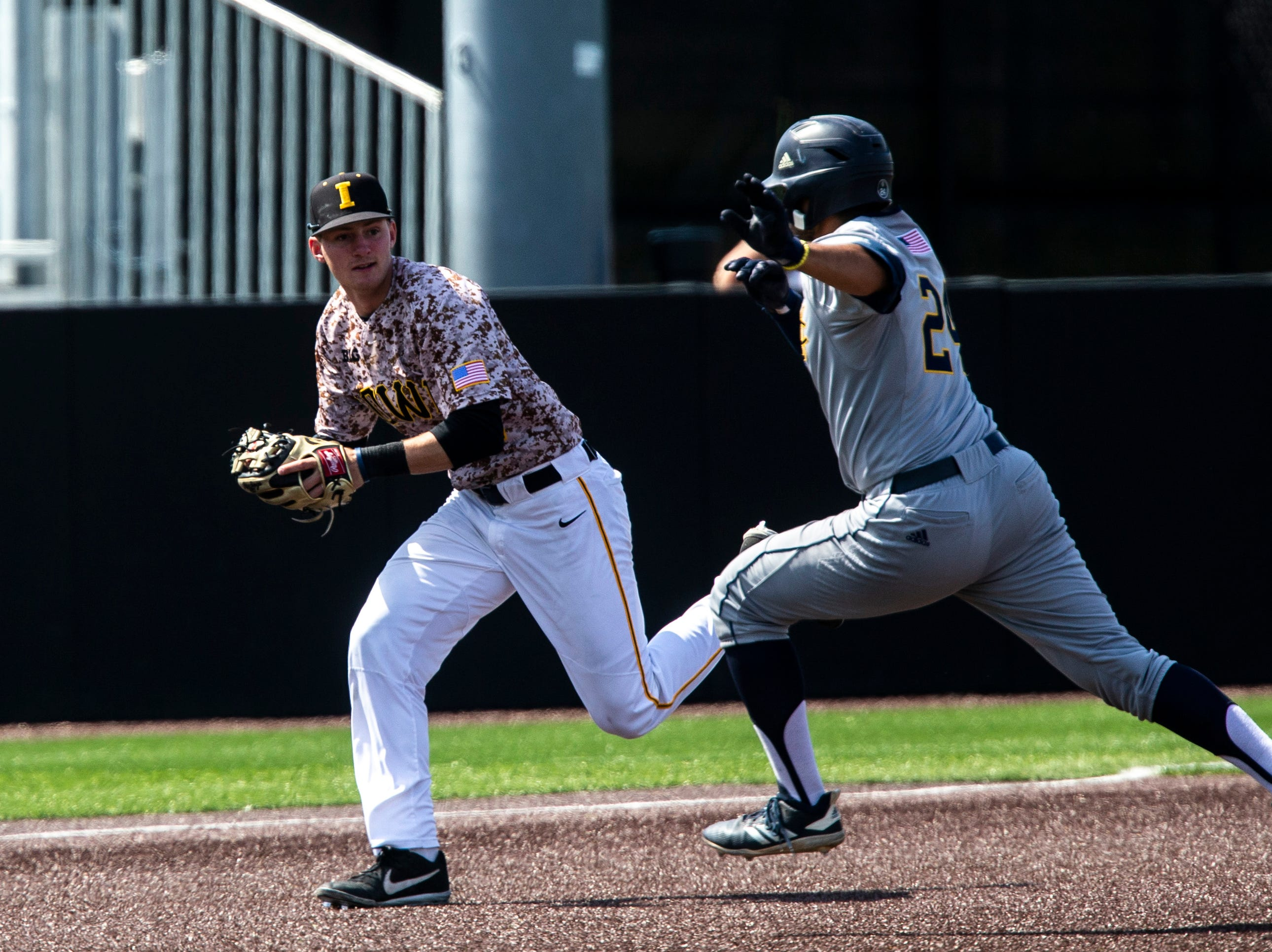 Iowa infielder Brendan Sher (2) tags University of California Irvine's Jacob Castro (24) ahead of third during a NCAA non conference baseball game, Sunday, May 5, 2019, at Duane Banks Field in Iowa City, Iowa.