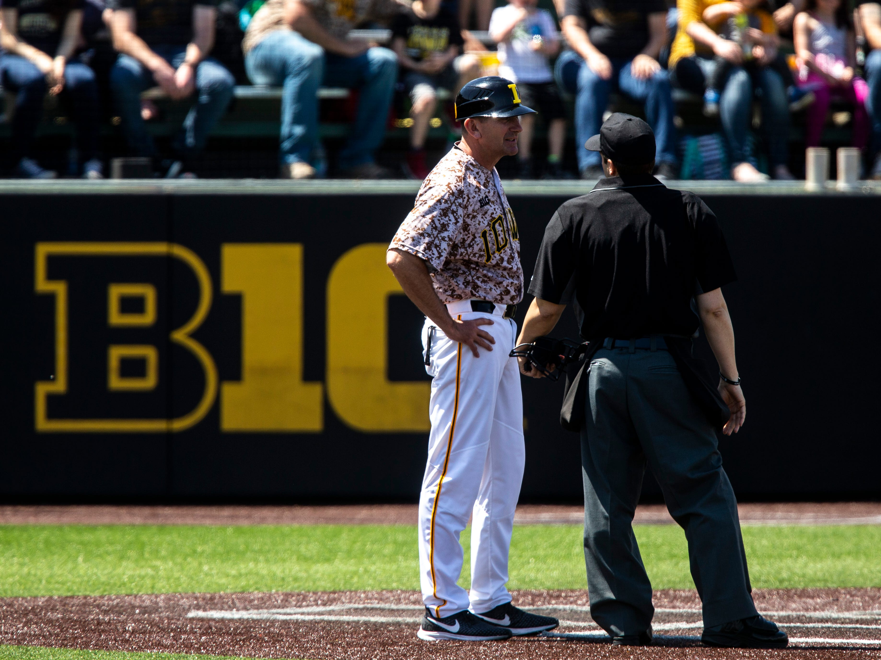 Iowa head coach Rick Heller talks with the home plate umprie during a NCAA non conference baseball game, Sunday, May 5, 2019, at Duane Banks Field in Iowa City, Iowa.