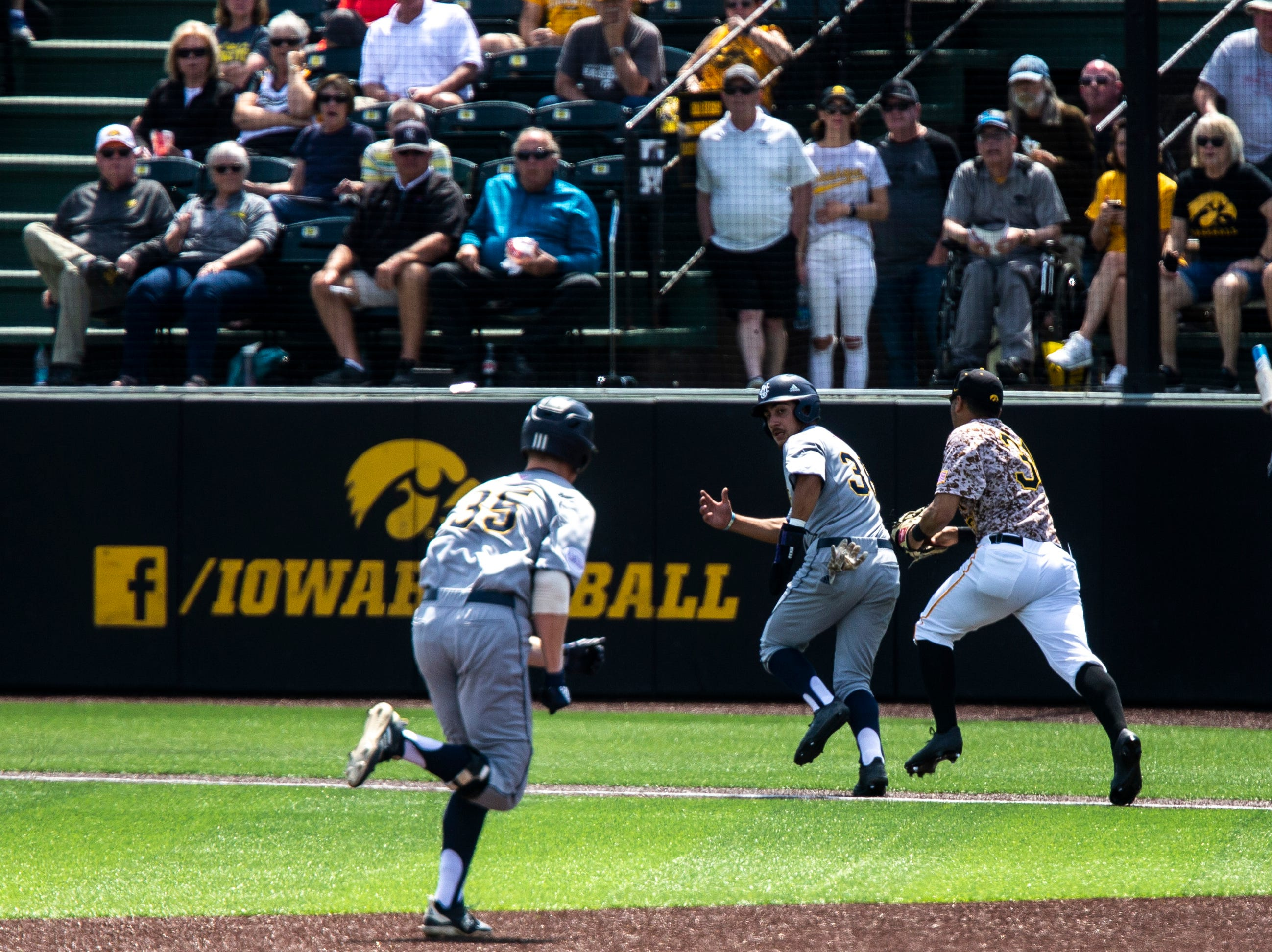 Iowa infielder Matthew Sosa (31) chases down University of California Irvine's Adrian Damla (36) during a NCAA non conference baseball game, Sunday, May 5, 2019, at Duane Banks Field in Iowa City, Iowa.