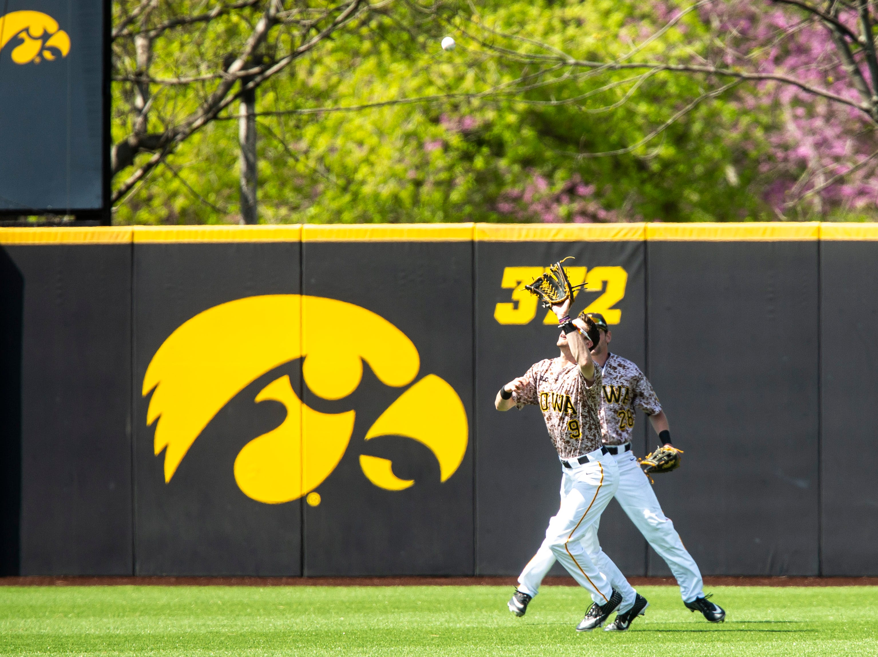 Iowa outfielder Ben Norman (9) gets an out in center field during a NCAA non conference baseball game, Sunday, May 5, 2019, at Duane Banks Field in Iowa City, Iowa.