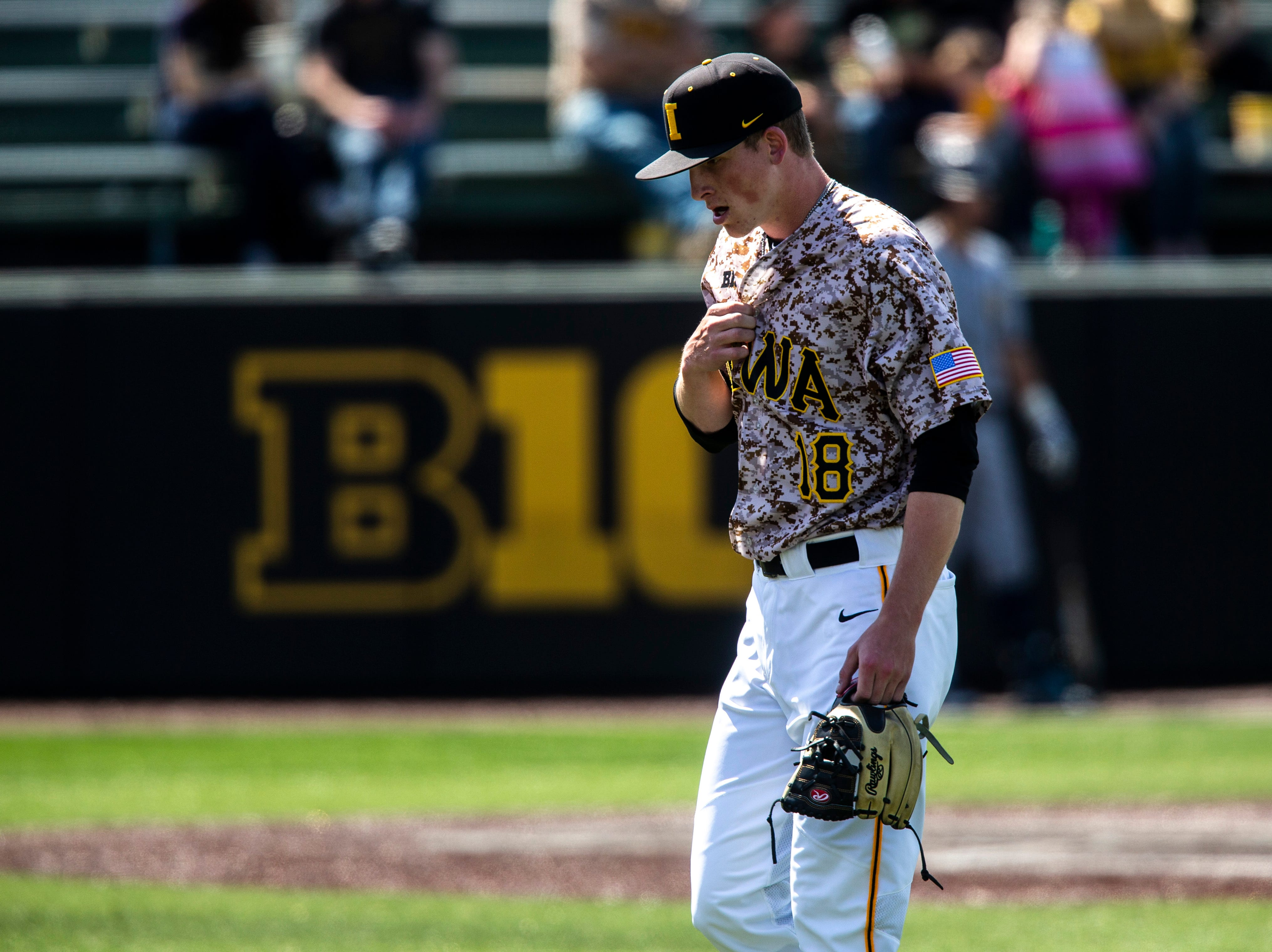 Iowa pitcher Shane Ritter (18) adjusts his jersey while heading to the dugout during a NCAA non conference baseball game, Sunday, May 5, 2019, at Duane Banks Field in Iowa City, Iowa.