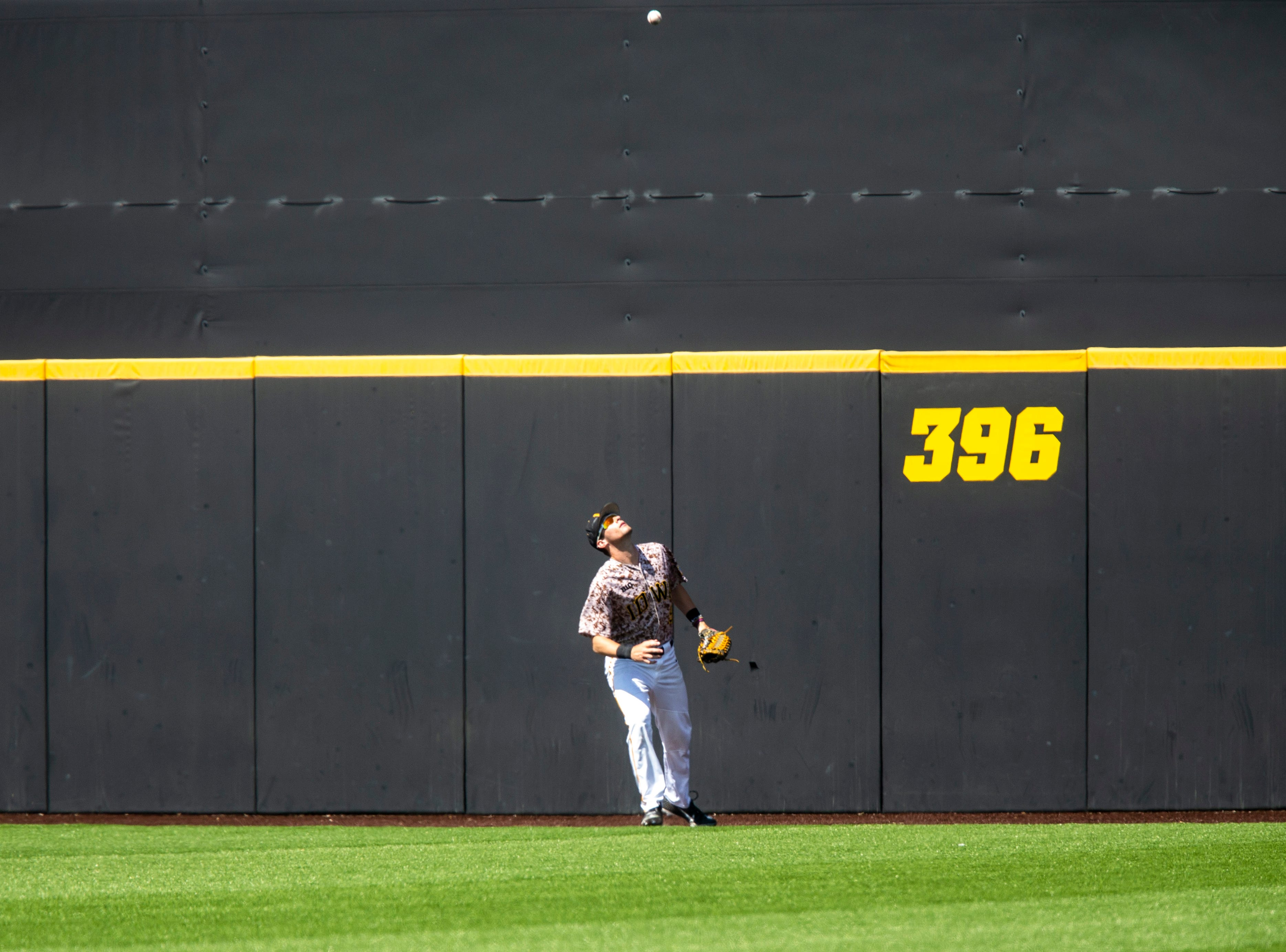Iowa outfielder Ben Norman (9) watches as a home run ball bounces off of the outfield wall during a NCAA non conference baseball game, Sunday, May 5, 2019, at Duane Banks Field in Iowa City, Iowa.