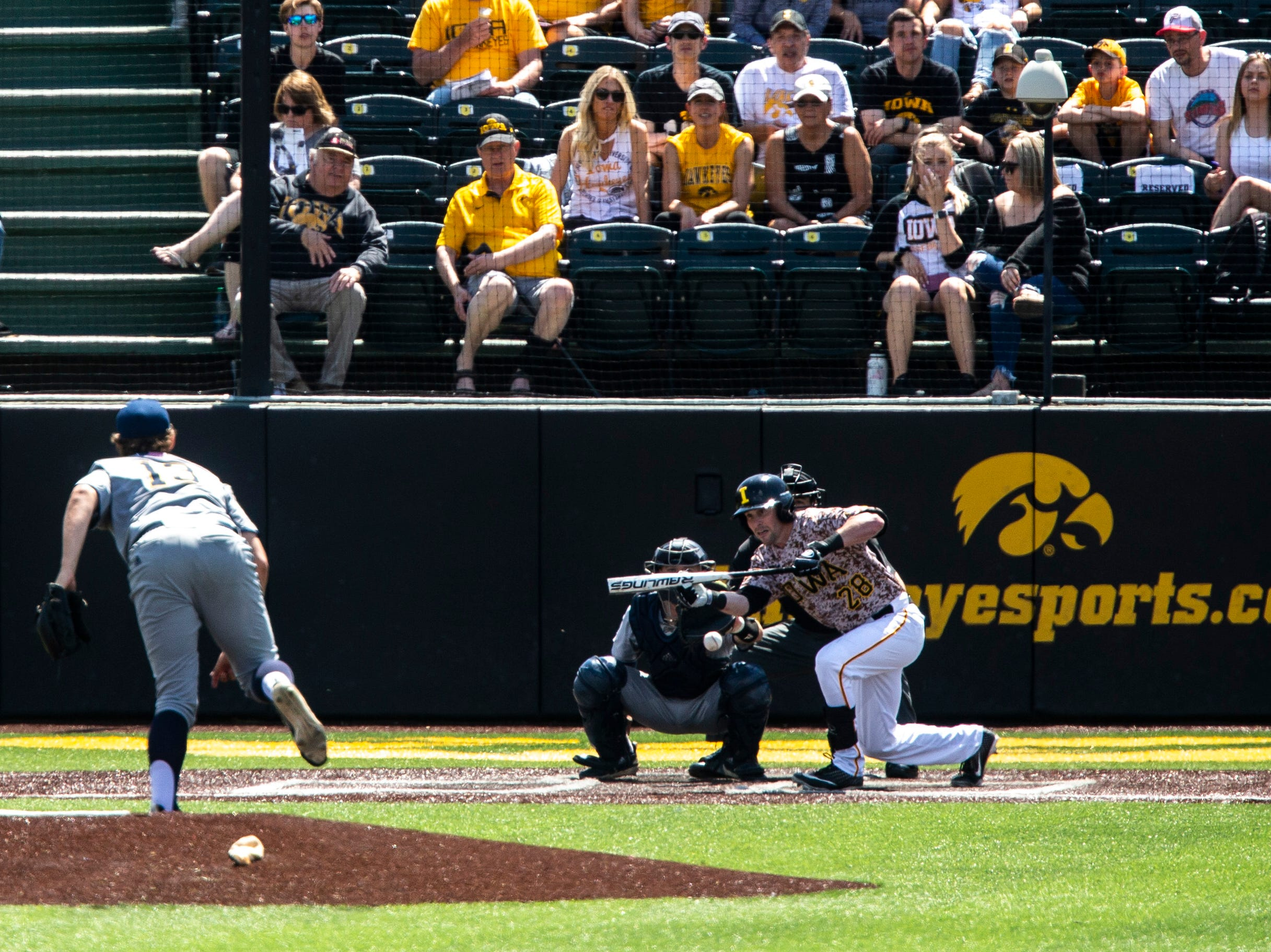 Iowa's Chris Whelan (28) bunts during a NCAA non conference baseball game, Sunday, May 5, 2019, at Duane Banks Field in Iowa City, Iowa.